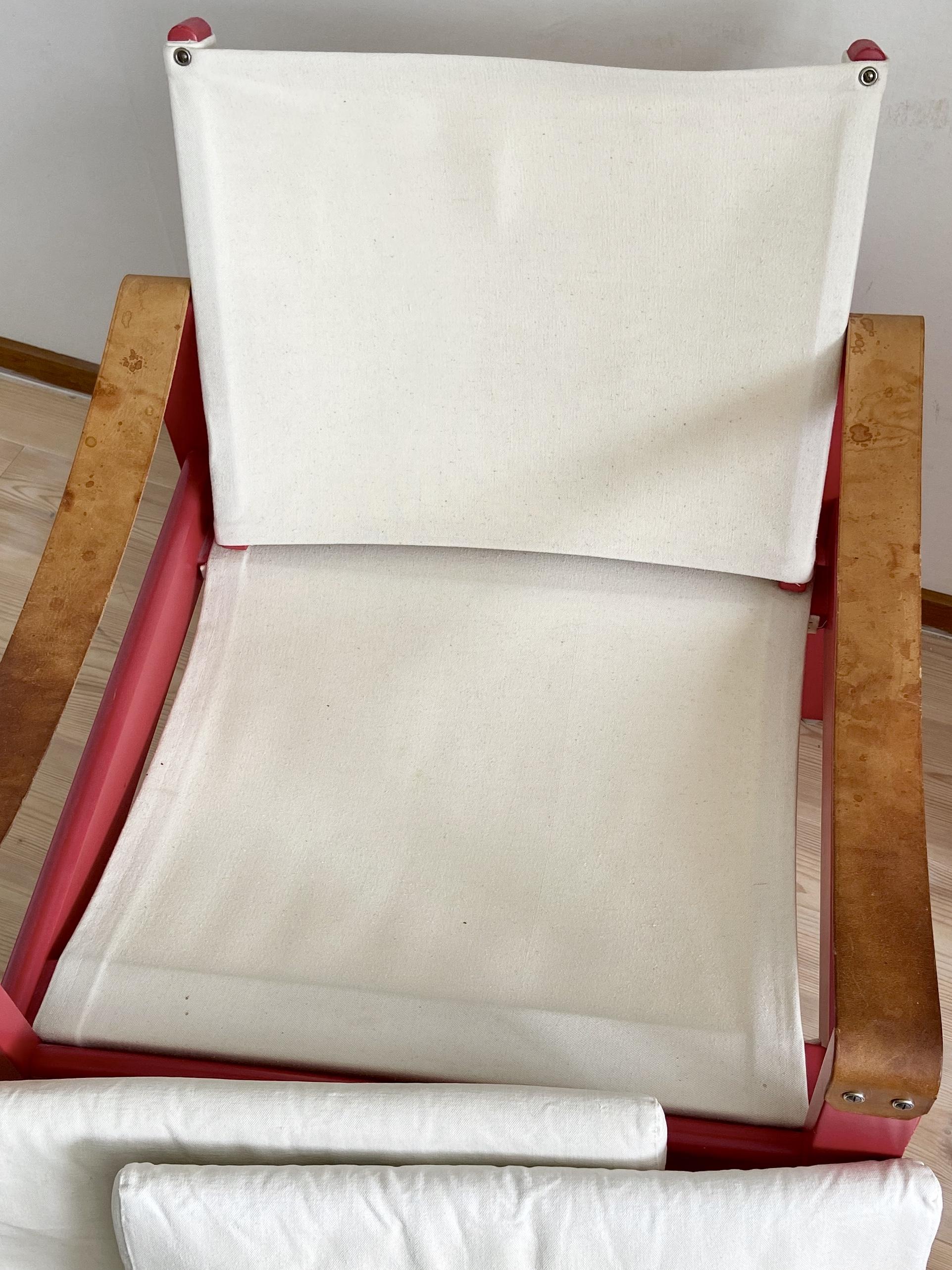 Vintage fåtölj med canvastyg och armstöd i läder
