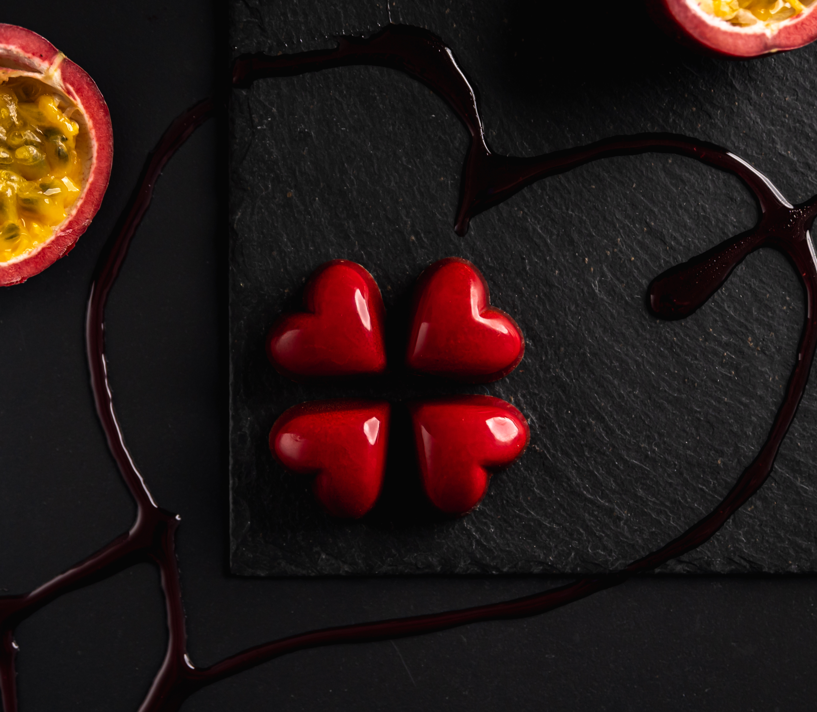 4 Milk chocolate Hearts filled with Passionfruit white chocolate caramel.
