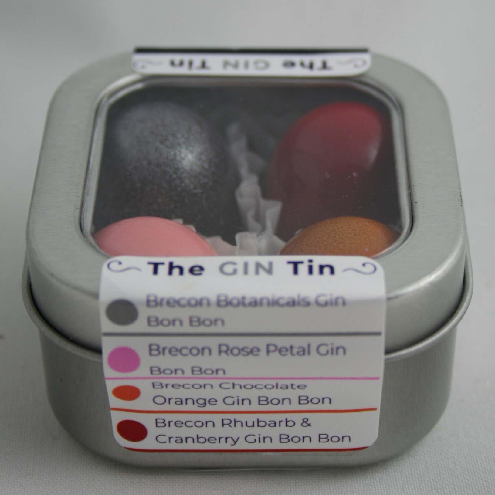 The Brecon Gin Tin. Dark Chocolate Botanicals. White chocolate Rose Gin. Milk Chocolate Orange Gin and Milk Chocolate Rhubarb and Cranberry Gi