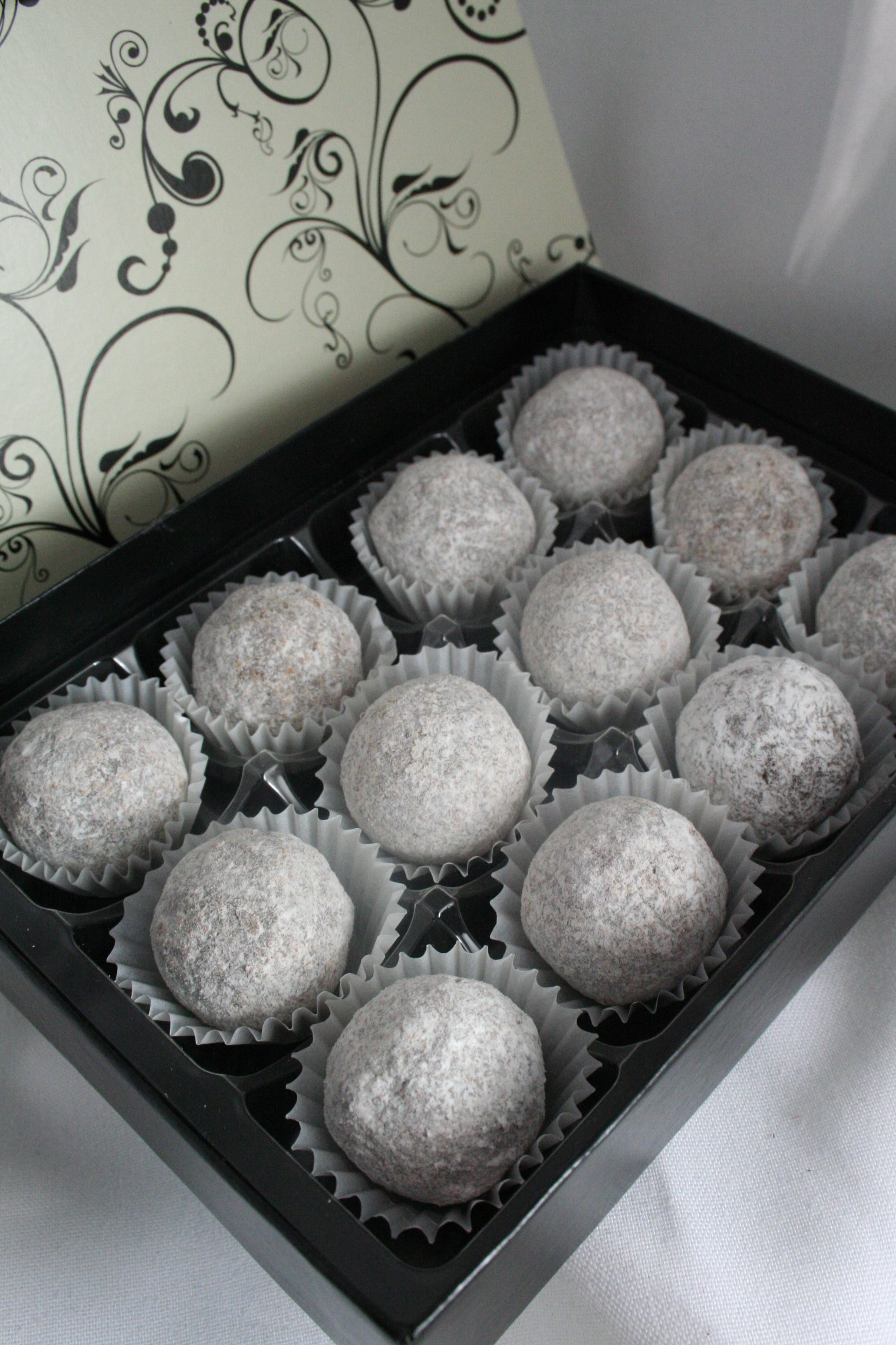 12 Milk Chocolate Marc de Champagne truffles. (Contain alcohol)