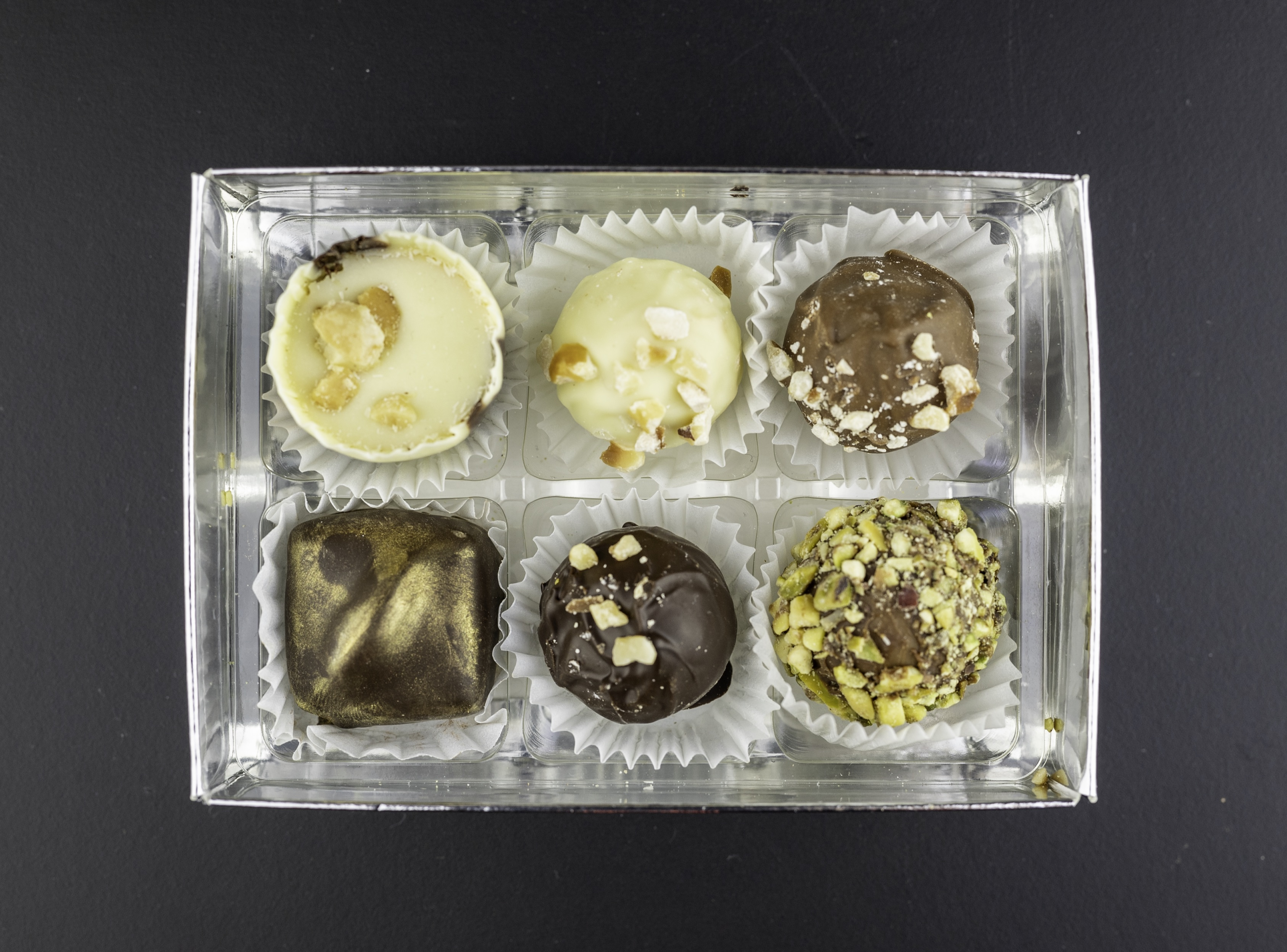 Nut Collection. White, Milk and Dark Hazelnut, Milk Pistachio, Dark Marzipan and Peanut butter cup.