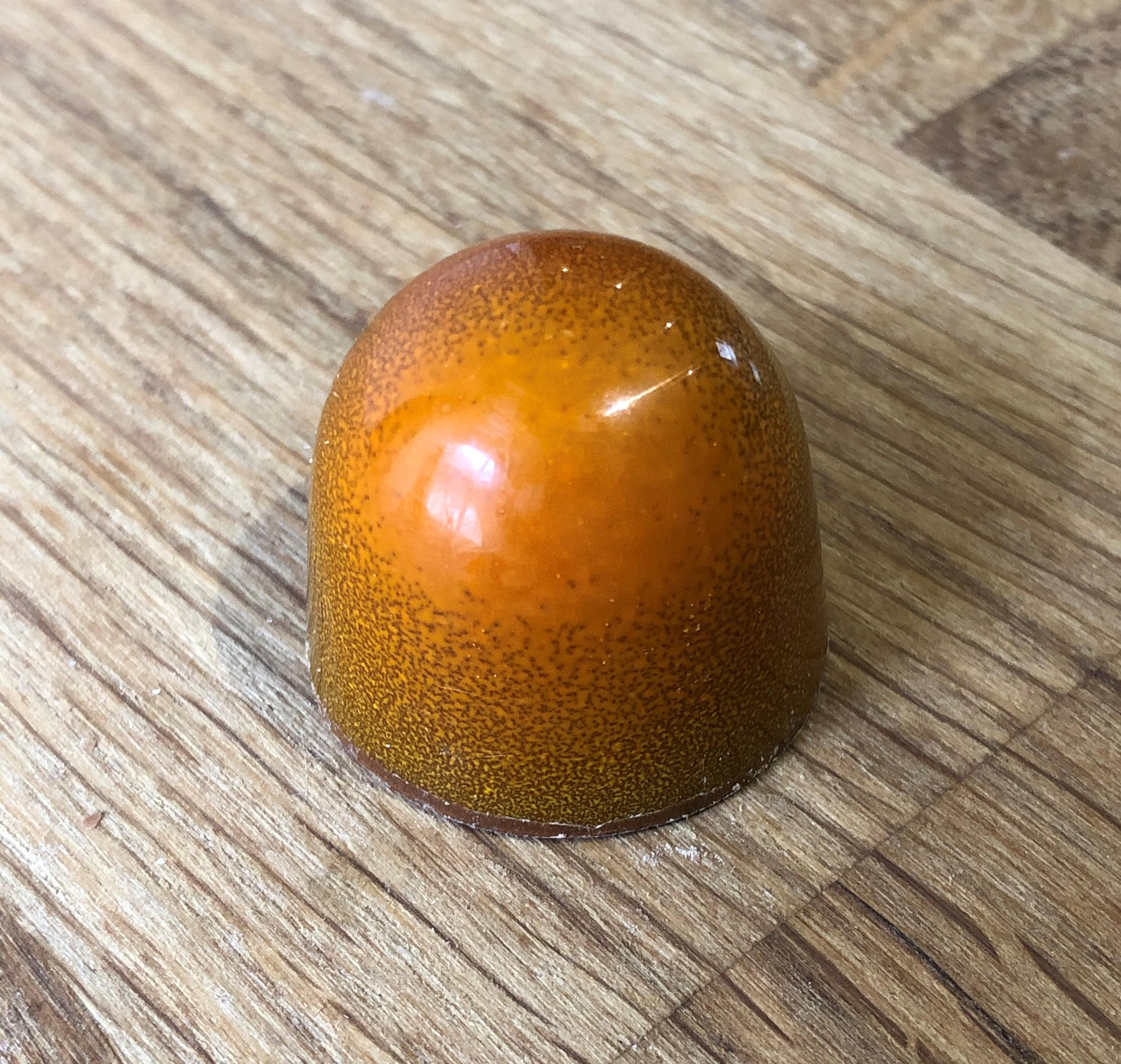 Brecon Chocolate Orange Gin. Milk Chocolate Bon Bon.
