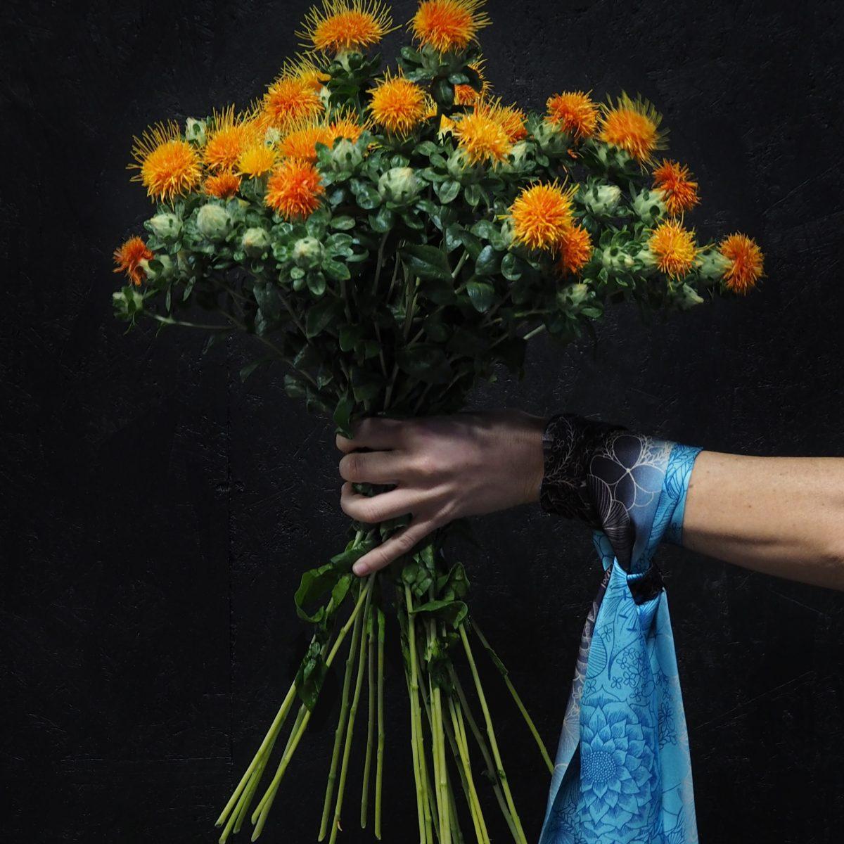 Kueen, Fabulously Fringe, Flora