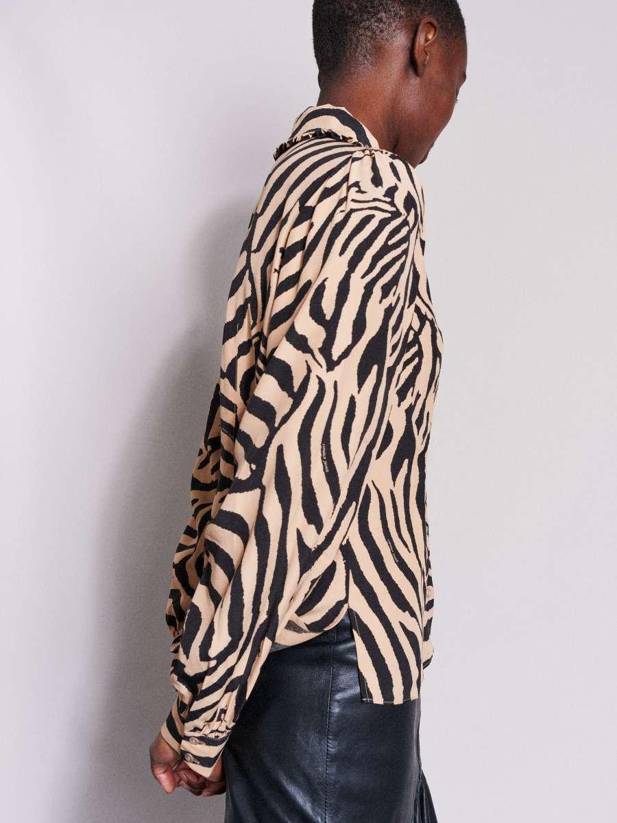 Catwalk Junkie - Blus El Tigre REA 25%