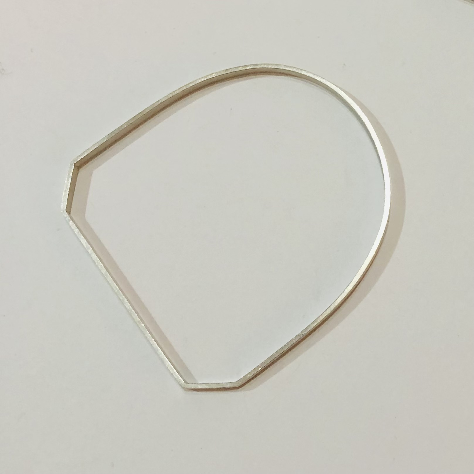 Minimal angled silver bracelet by Gracie Hinitt