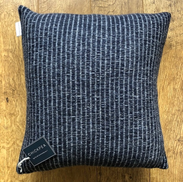 Minimal geometric lambswool knitted cushion by Harriett Grist