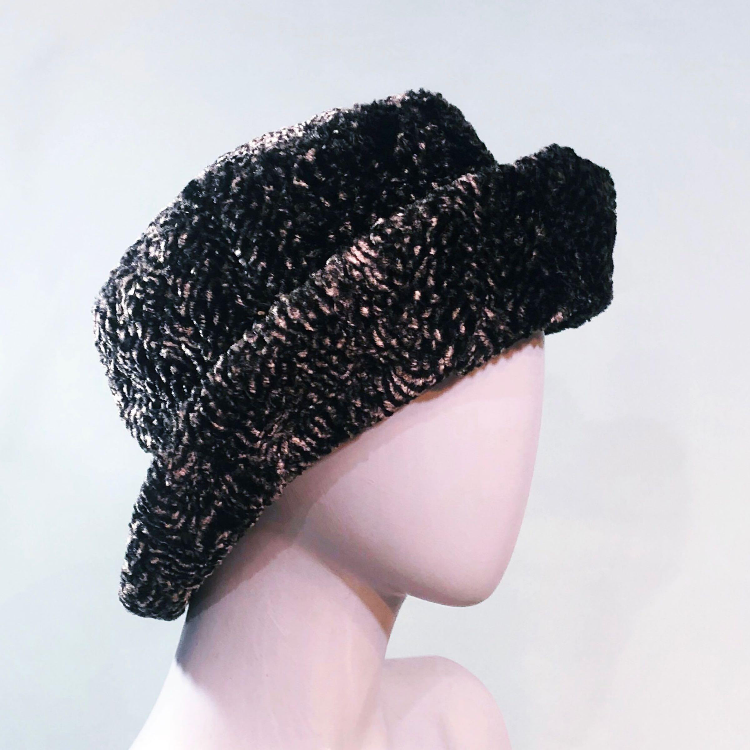 Grey astrakhan style hat