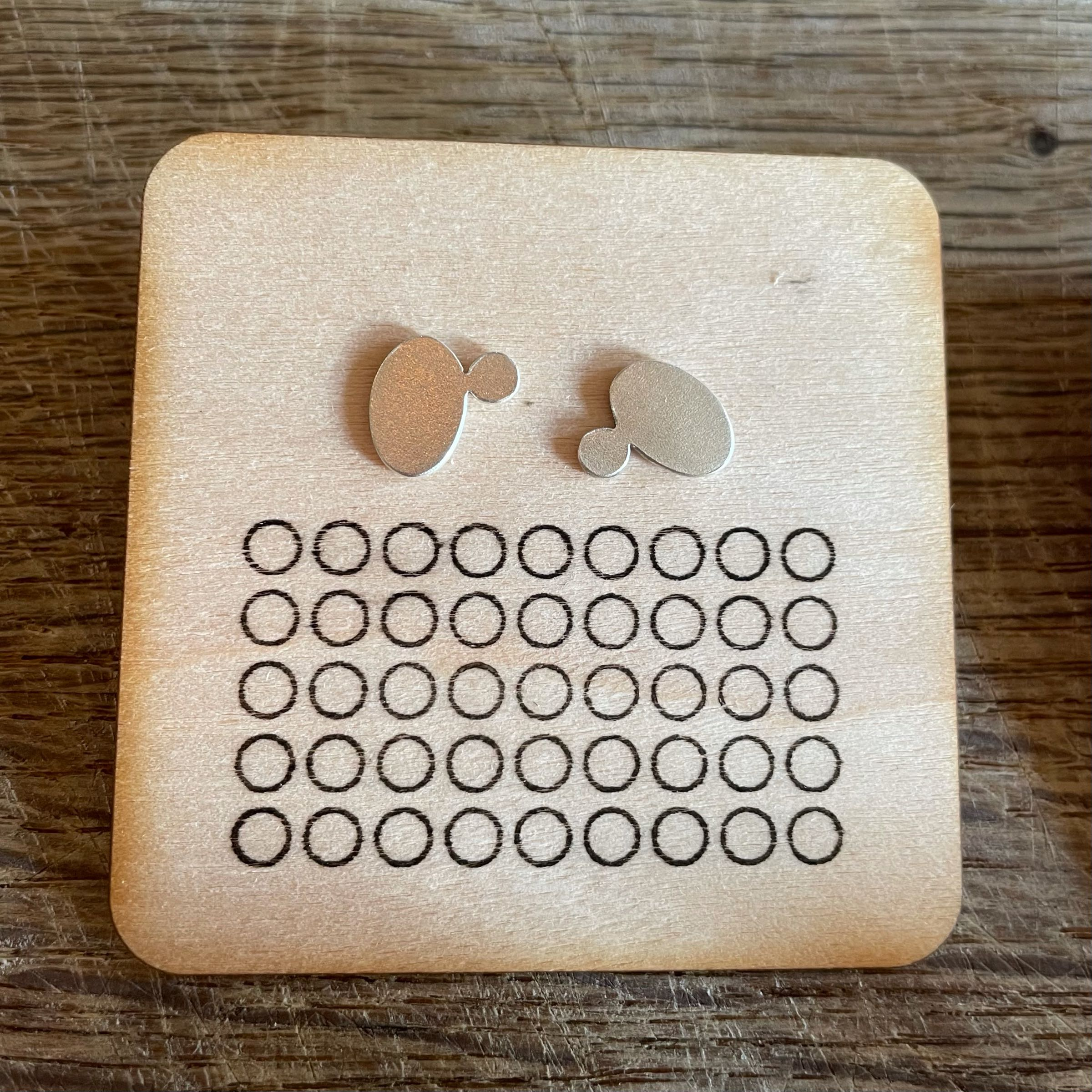 Silver oval and tiny circle earring studs by Gracie Hinitt