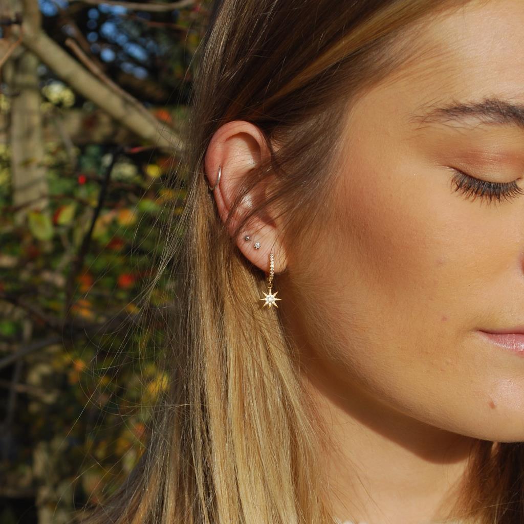White Cubic Zirconia star & moon drop huggie earring in gold