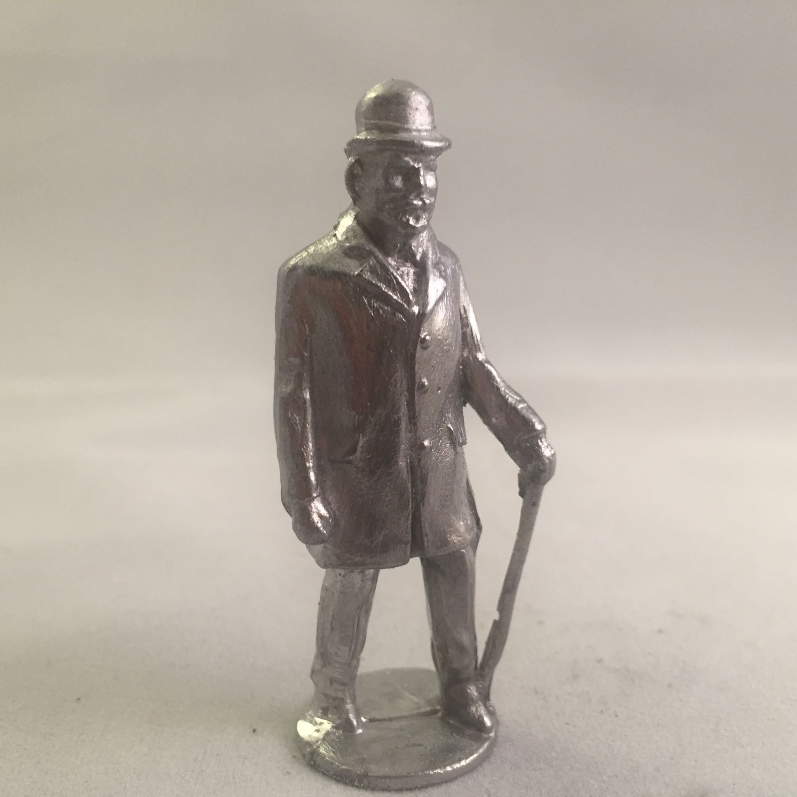 B57. Old Man walking with cane.