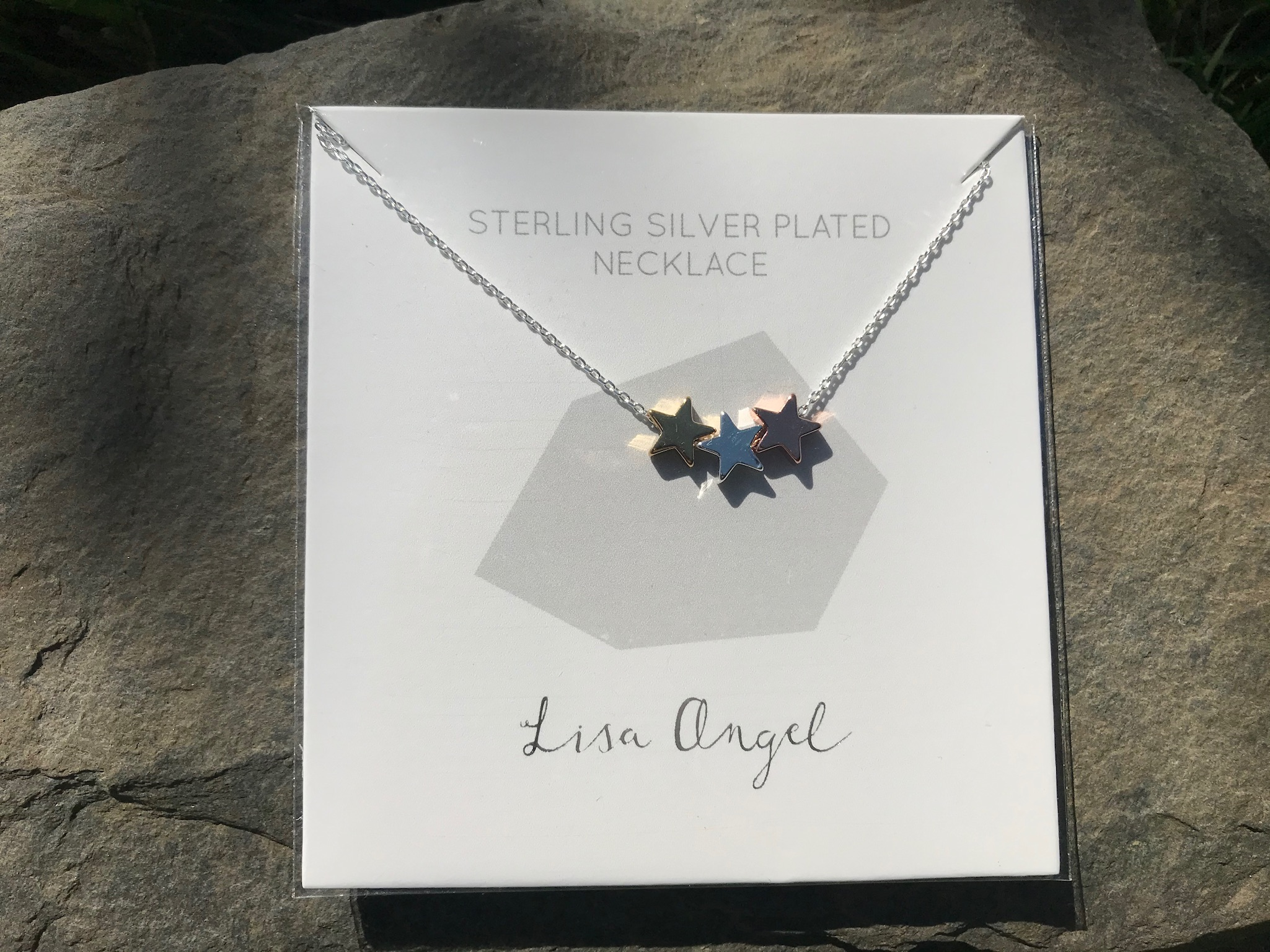 Lisa Angel star necklace with silver gold and rose gold stars
