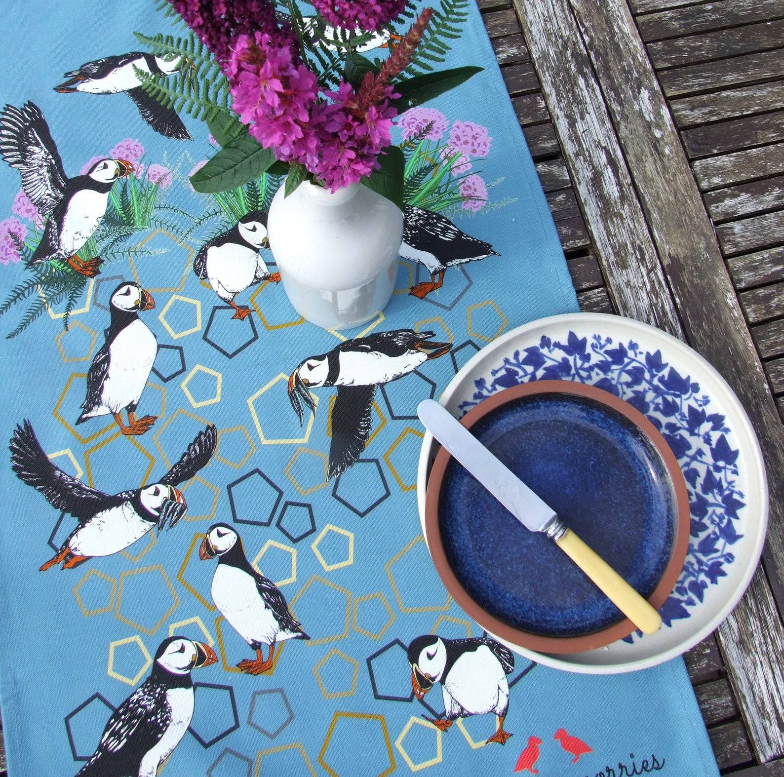 Tammie Norries A Circus of Puffins Tea Towel