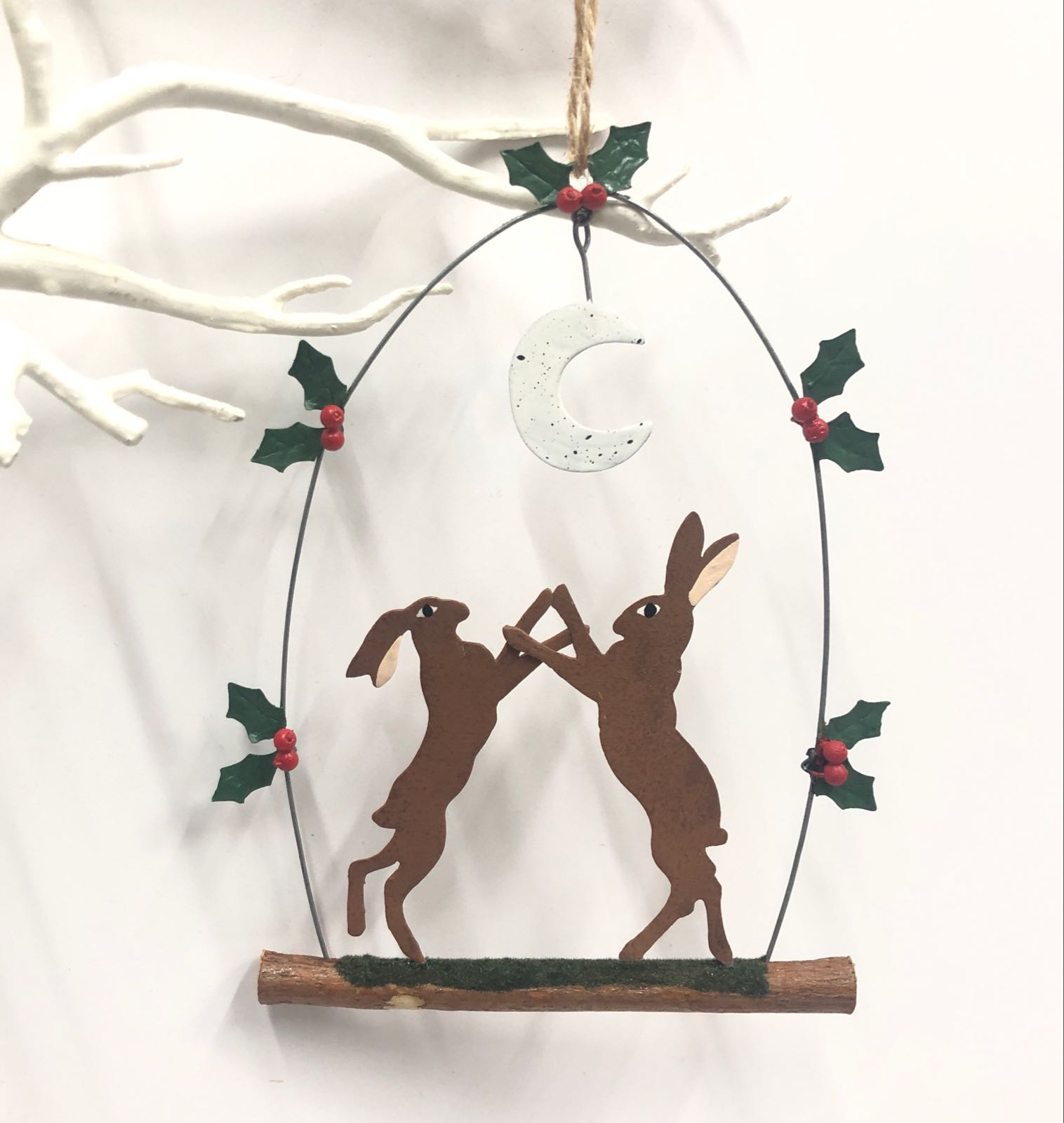 Boxing hares under the moon. Hanging Christmas decoration by shoeless joe