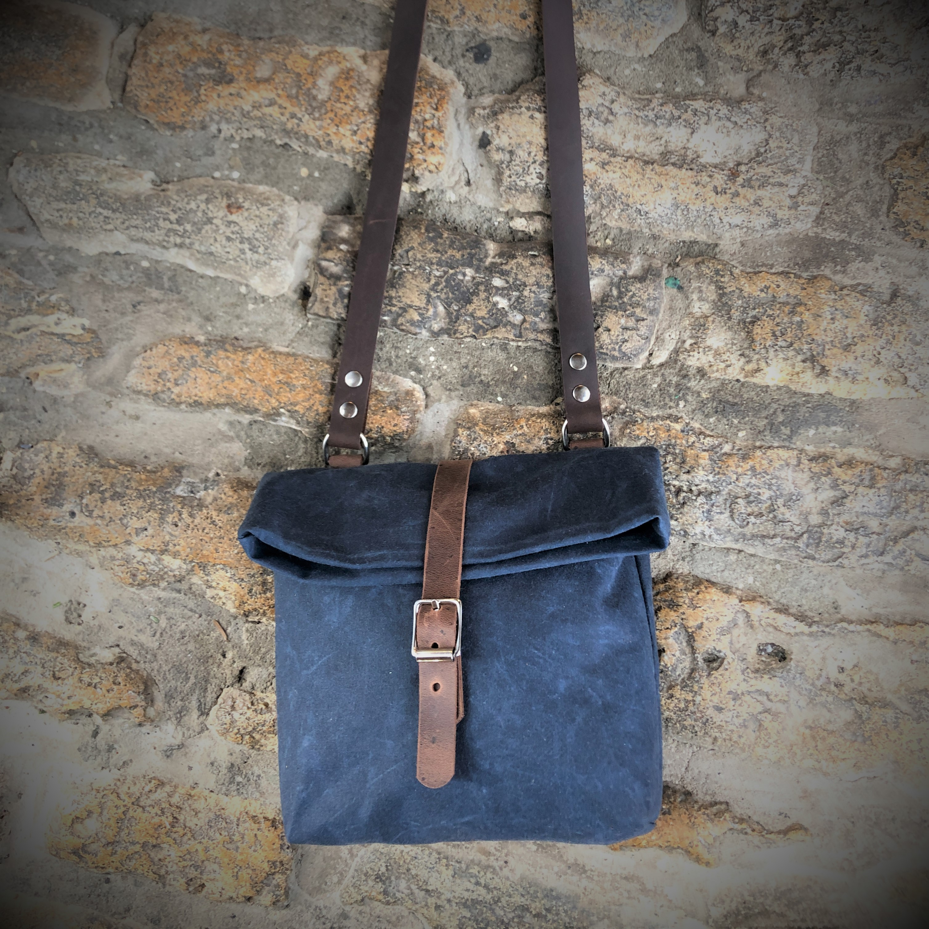 Waxed canvas and leather roll down hand bag