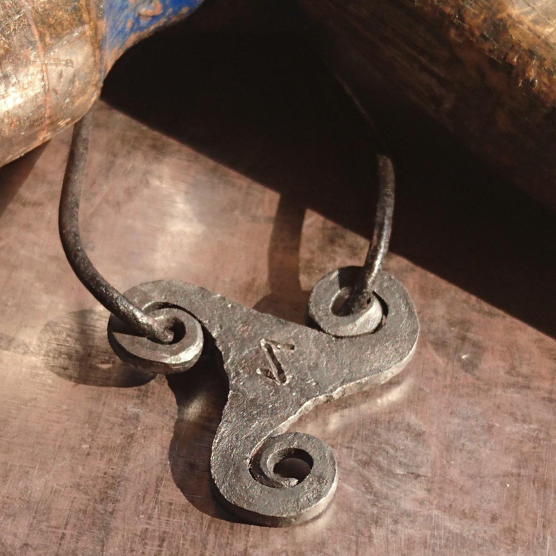 Triskilion iron pendant