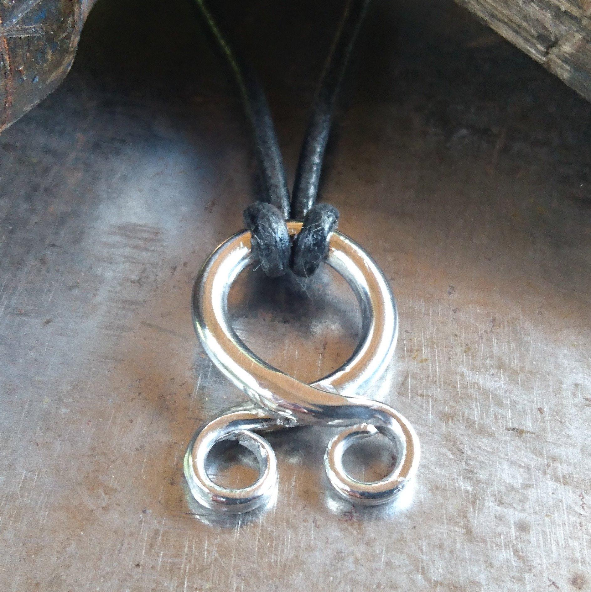 Troll cross silver pendant