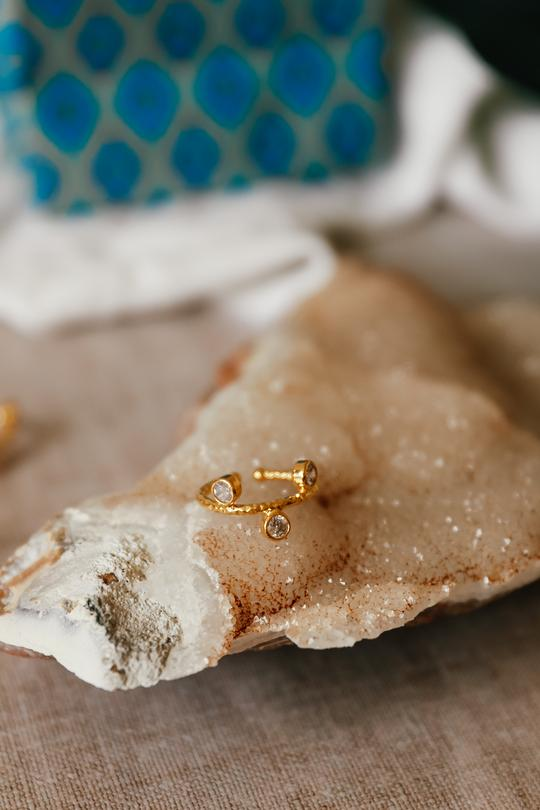 Hammered gold ring with crystal detail