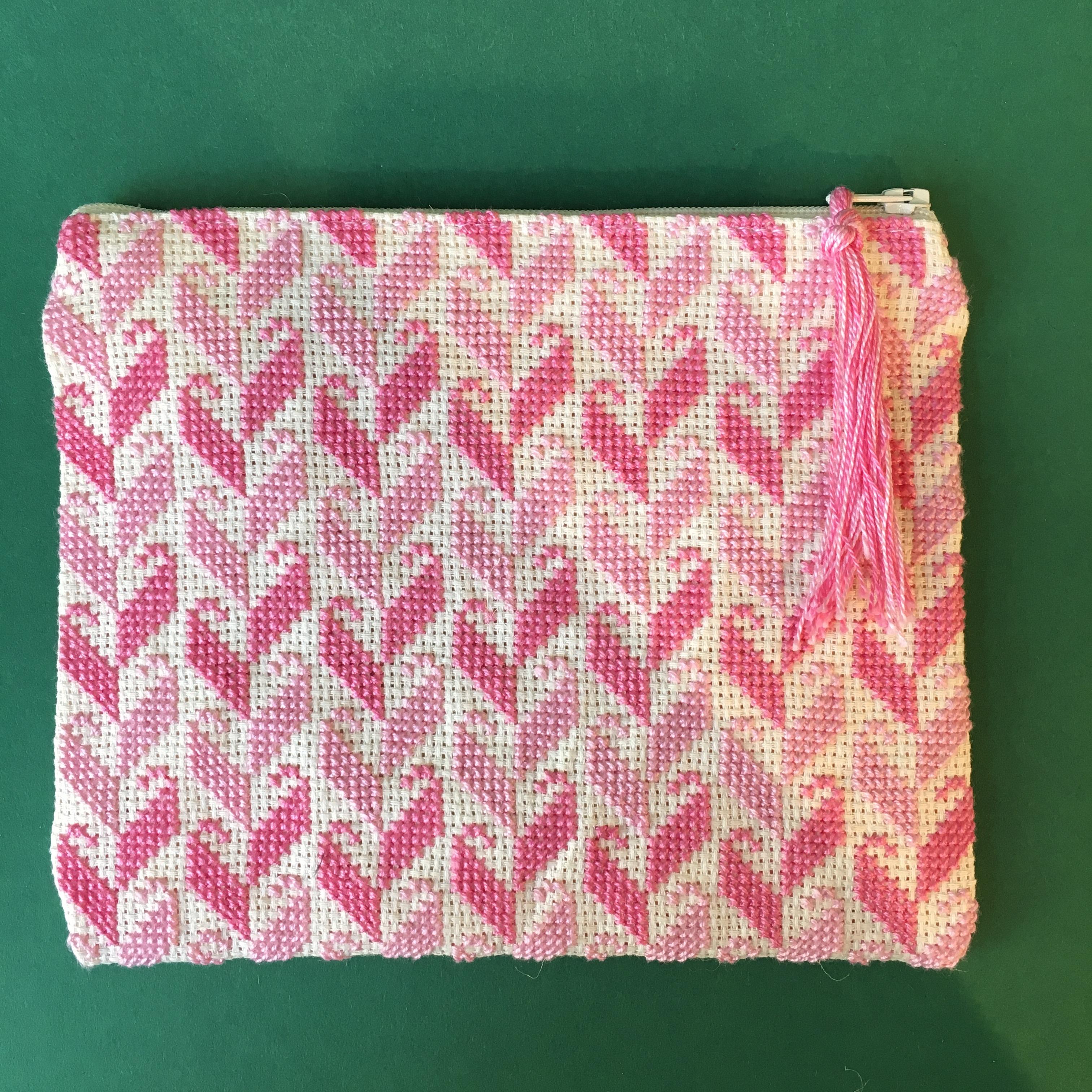 Stor brodert pung, hvit og rosa