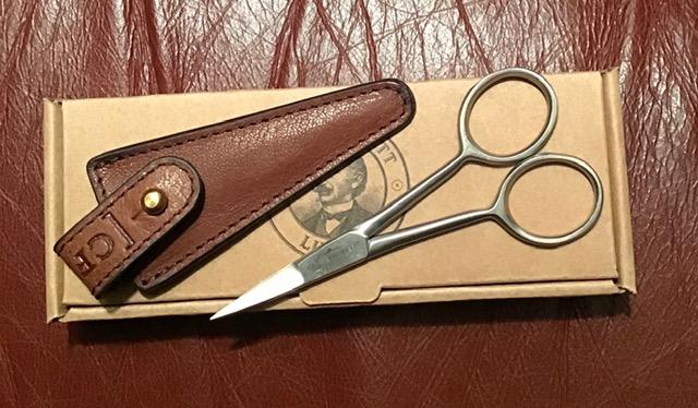 Beard scissors in leather pouch