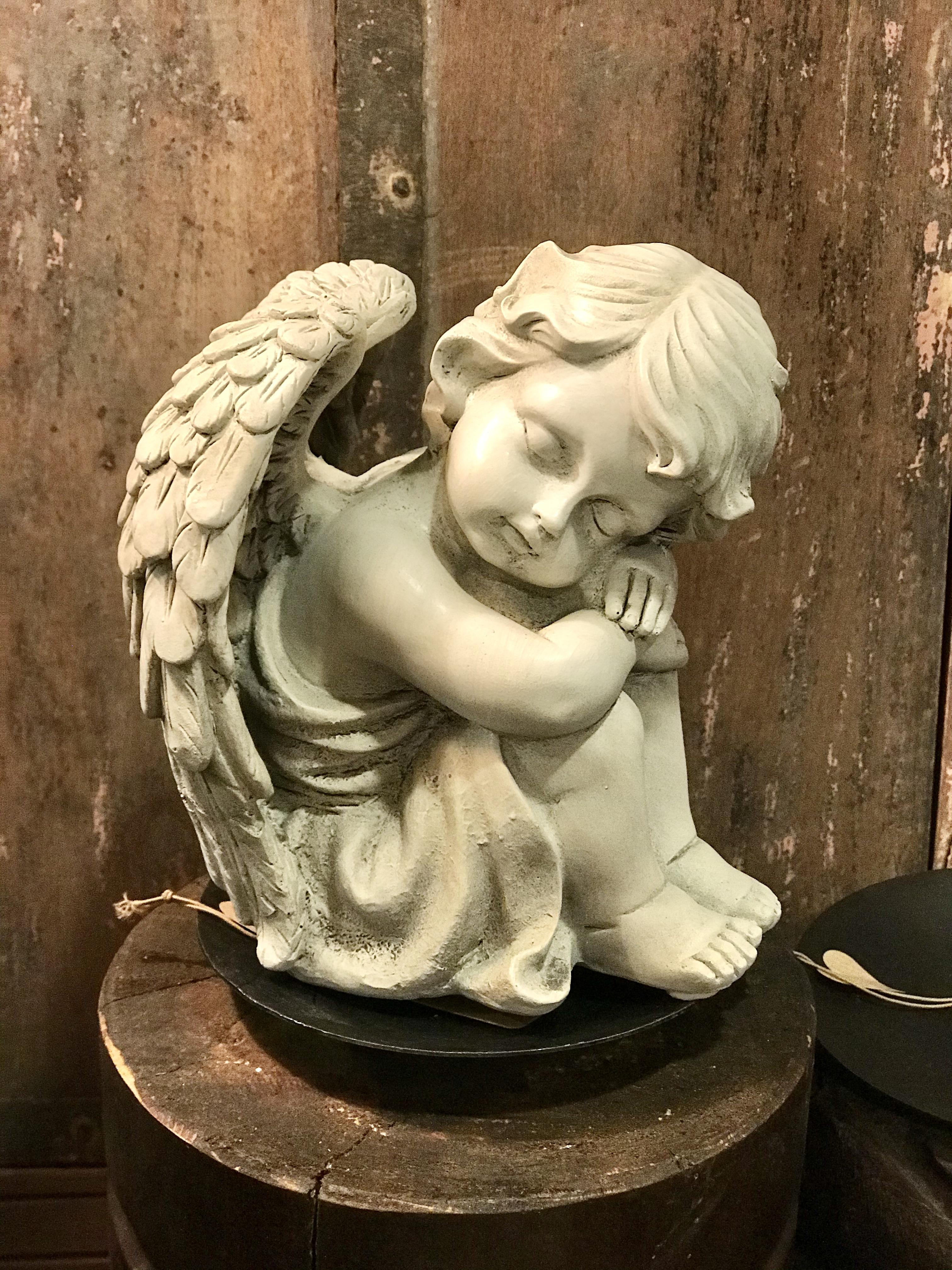 Ängel sittande barn