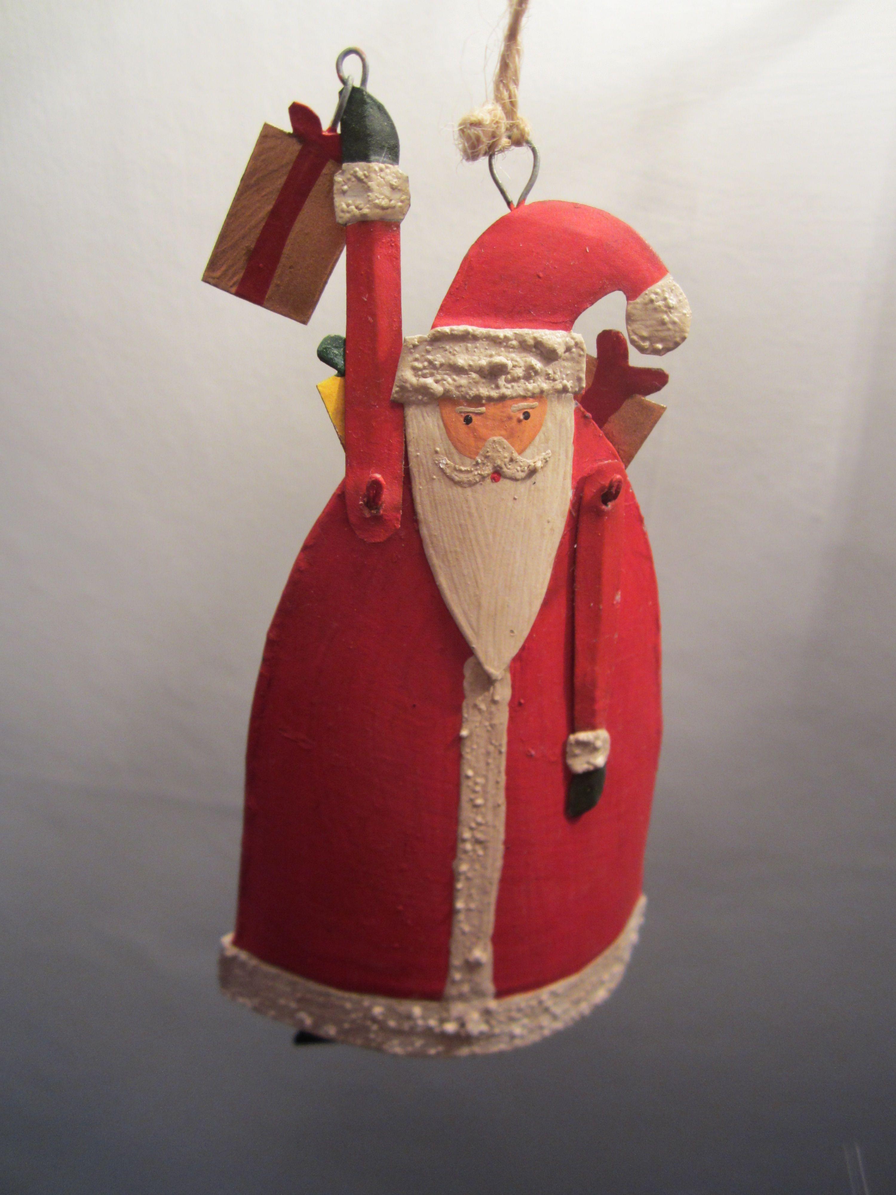 Tin Santa Carrying Presents