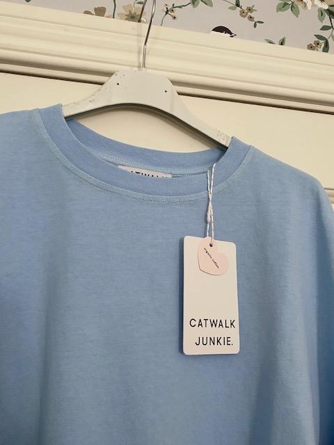 Ljusblå t-shirt