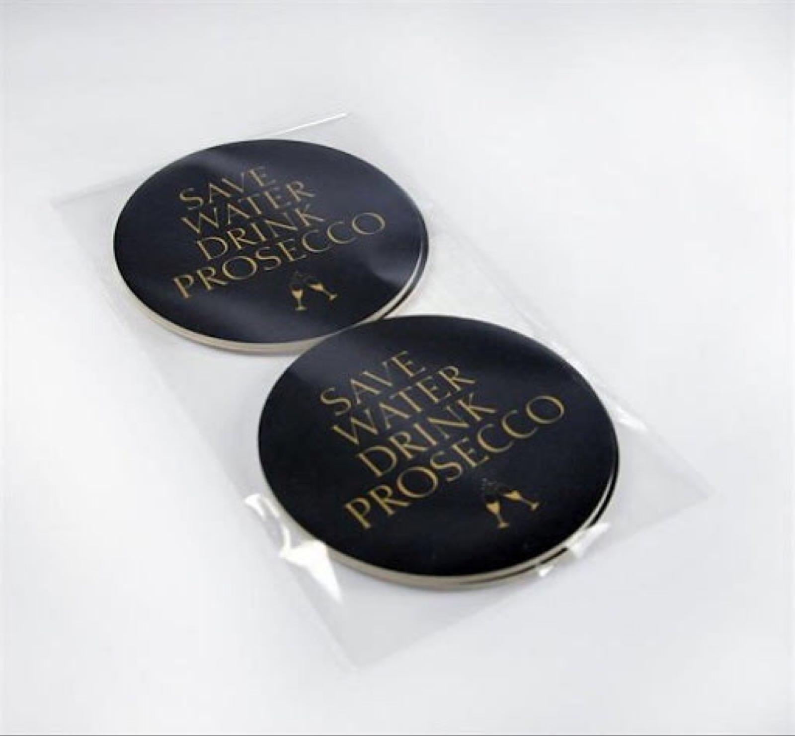 Mellow Design - Glasunderlägg 4-p, Prosecco, svart/guldtext