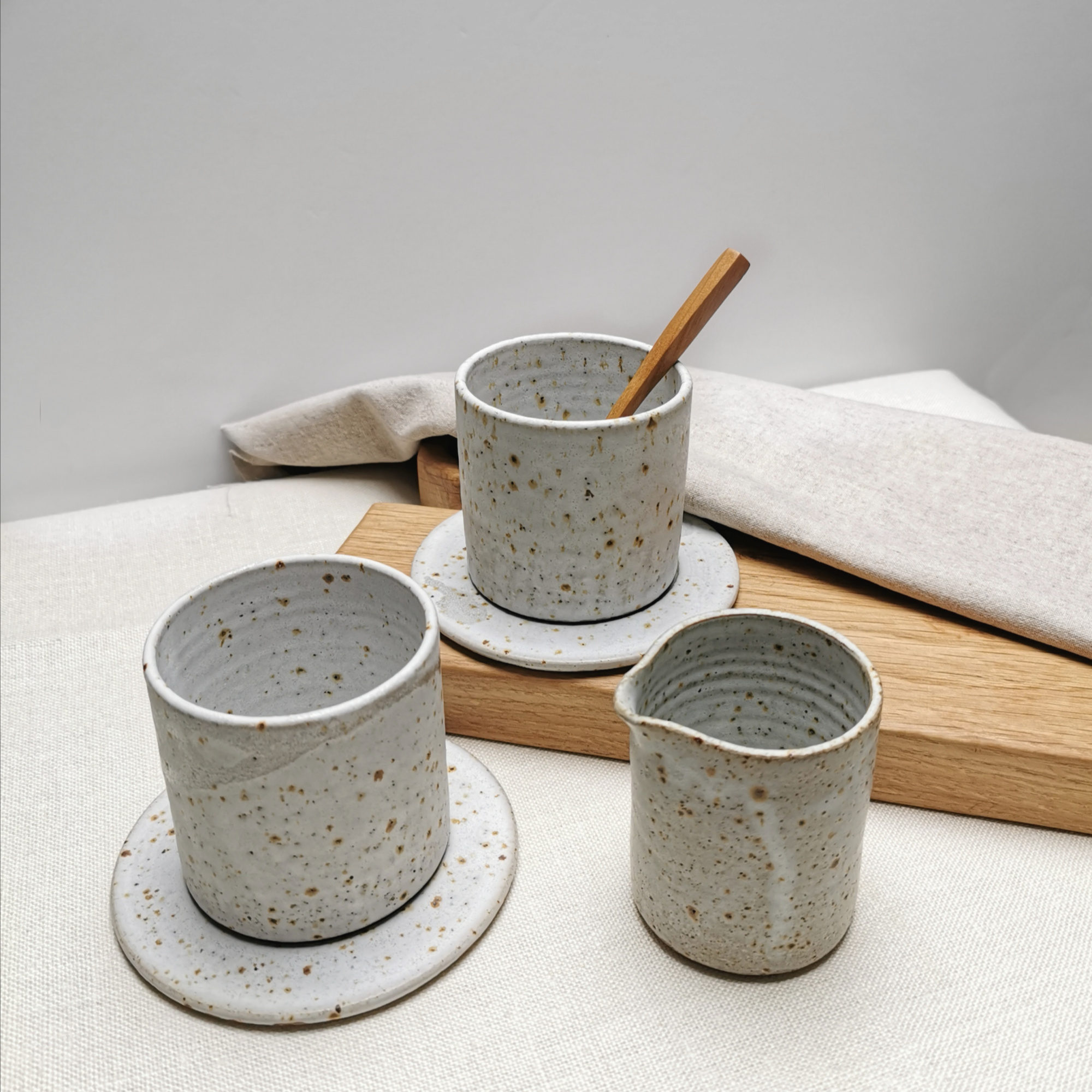 Cup and Saucers by Aku Ceramics