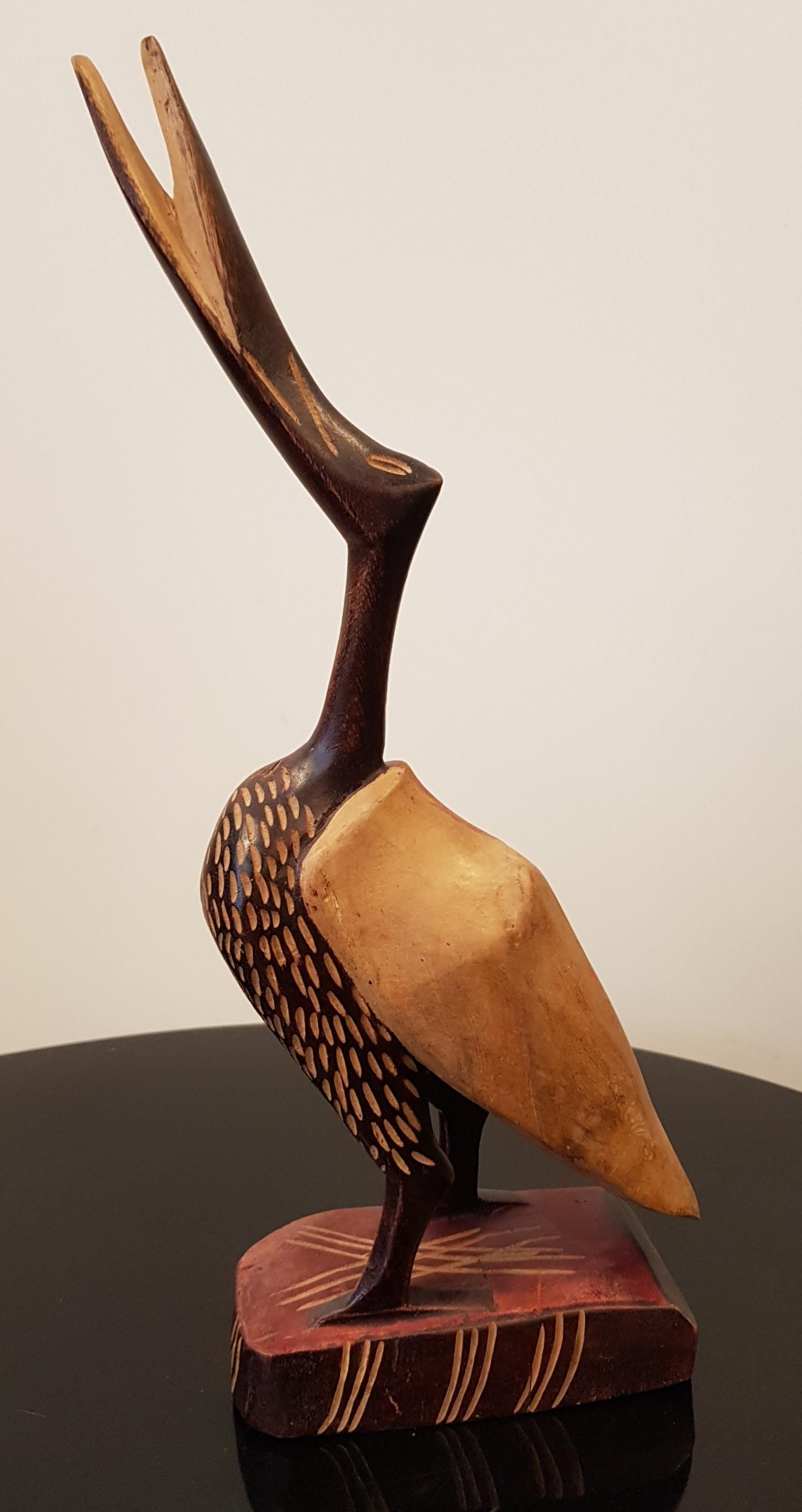 Puuveistos lintu Haiti