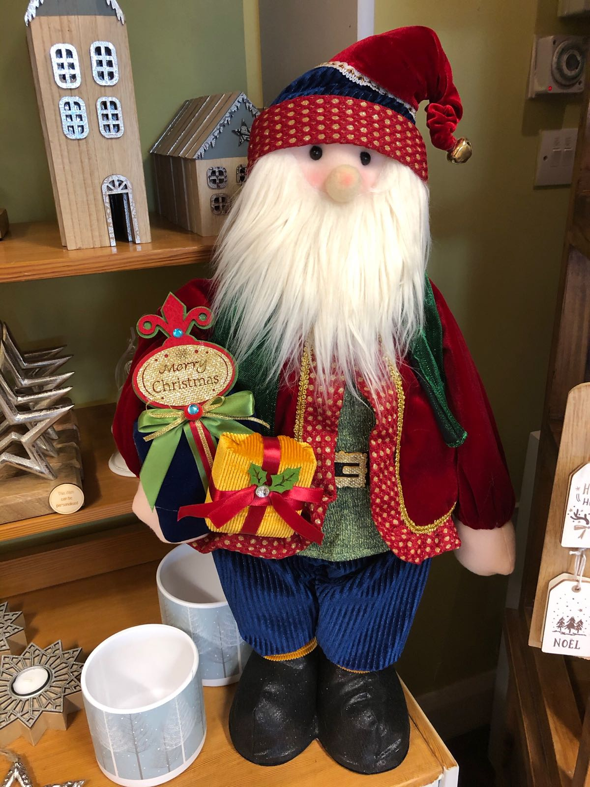 Large standing Santa with present