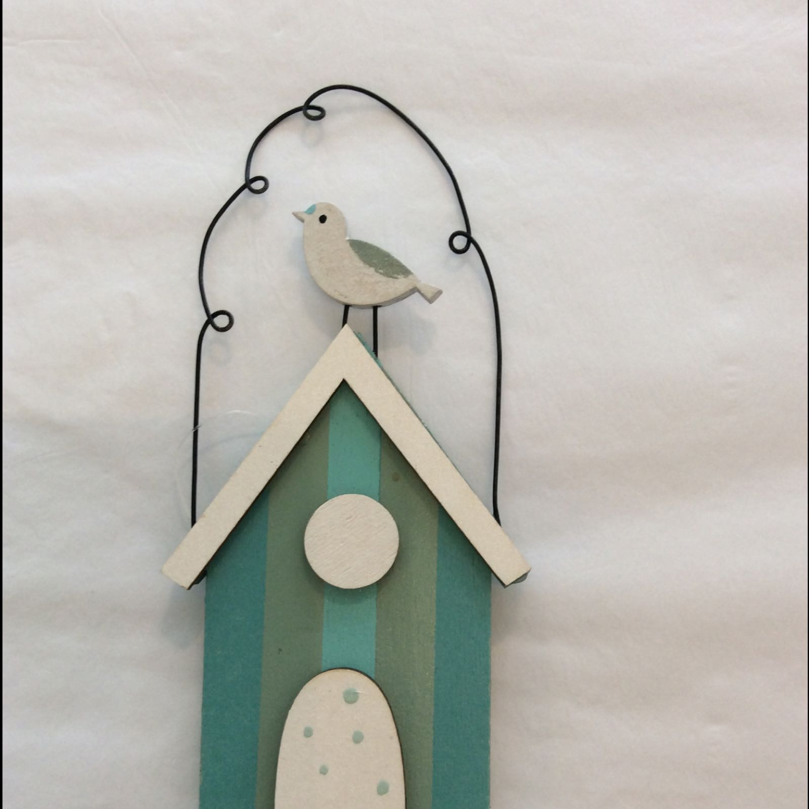 Beach hut with seagull hanger