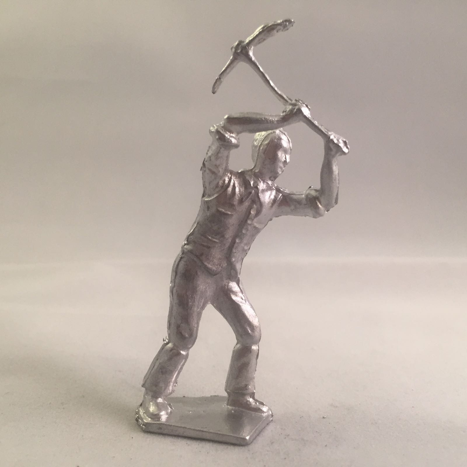 B5. Road Workman with Pick Axe