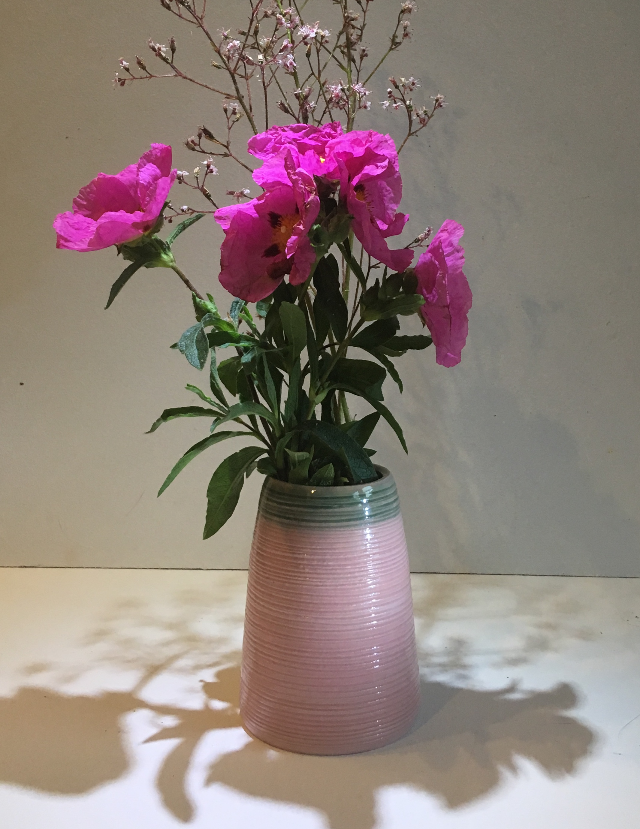 Pink vase with green rim