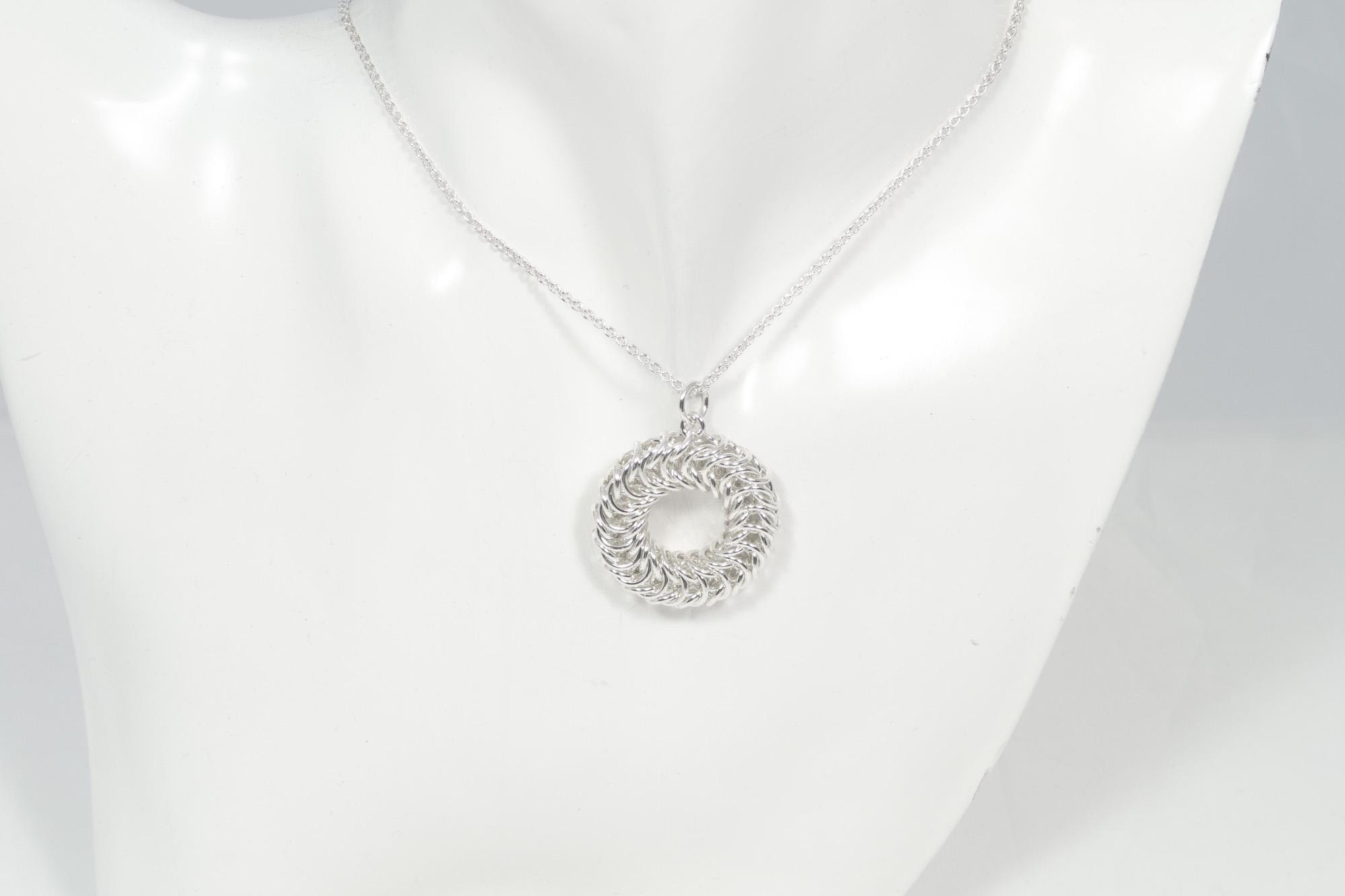 Dronning Sirkel - anheng sølv