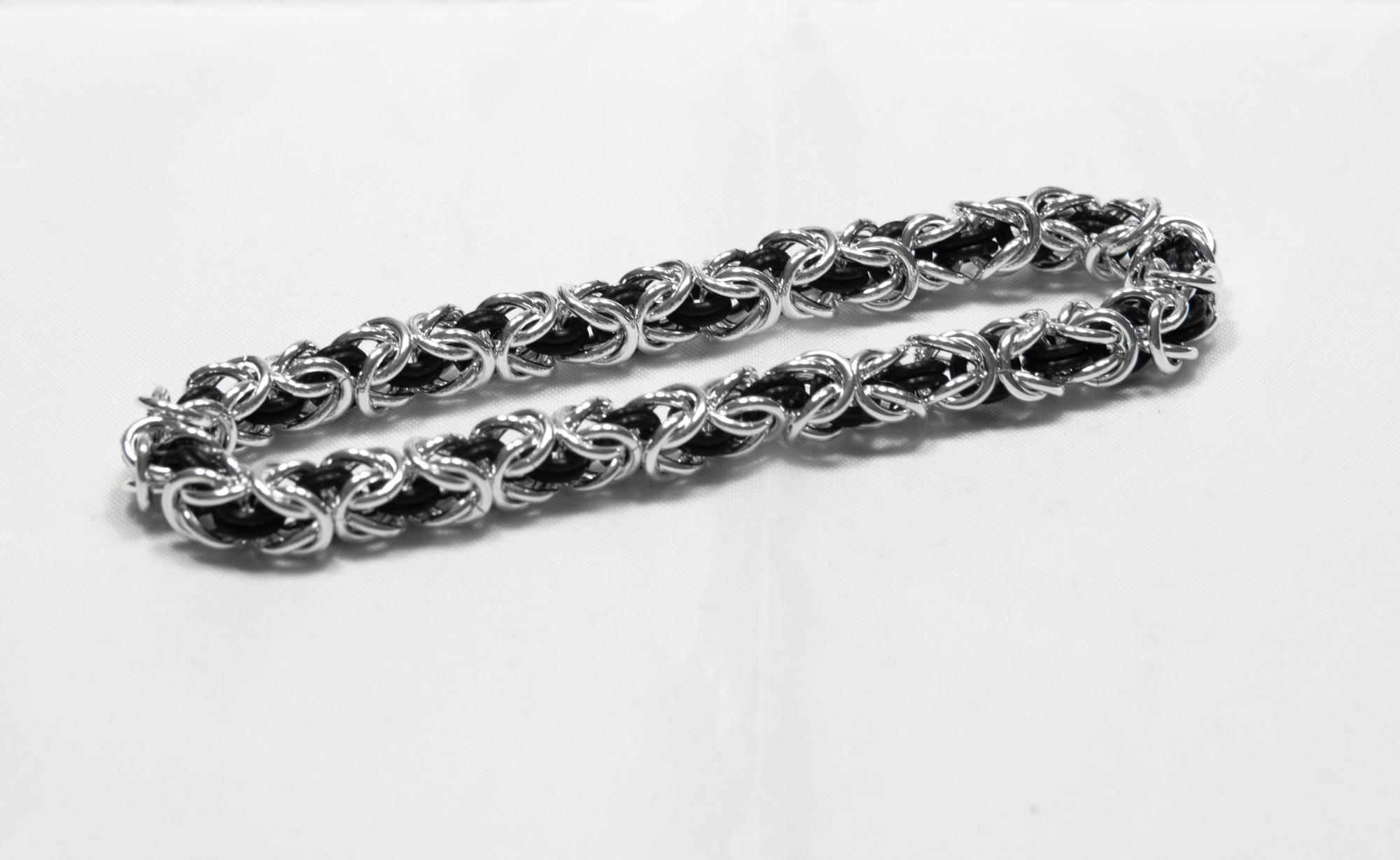 Konge med gummiringer - armbånd sølv