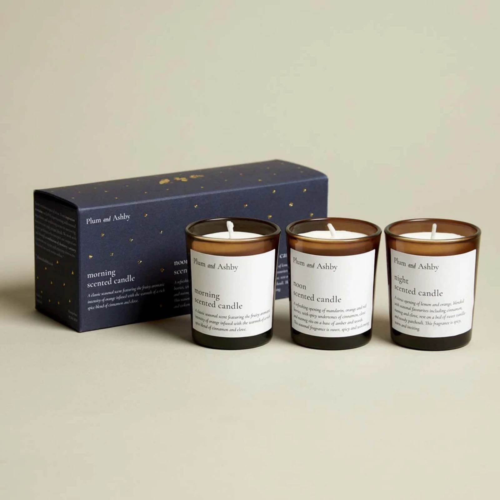 Plum & Ashby Christmas votive candle gift set- includes x1 pink peppercorn and nutmeg candle x1 fireside embers candle and x1 clove and nutmeg candle presented in a gift box