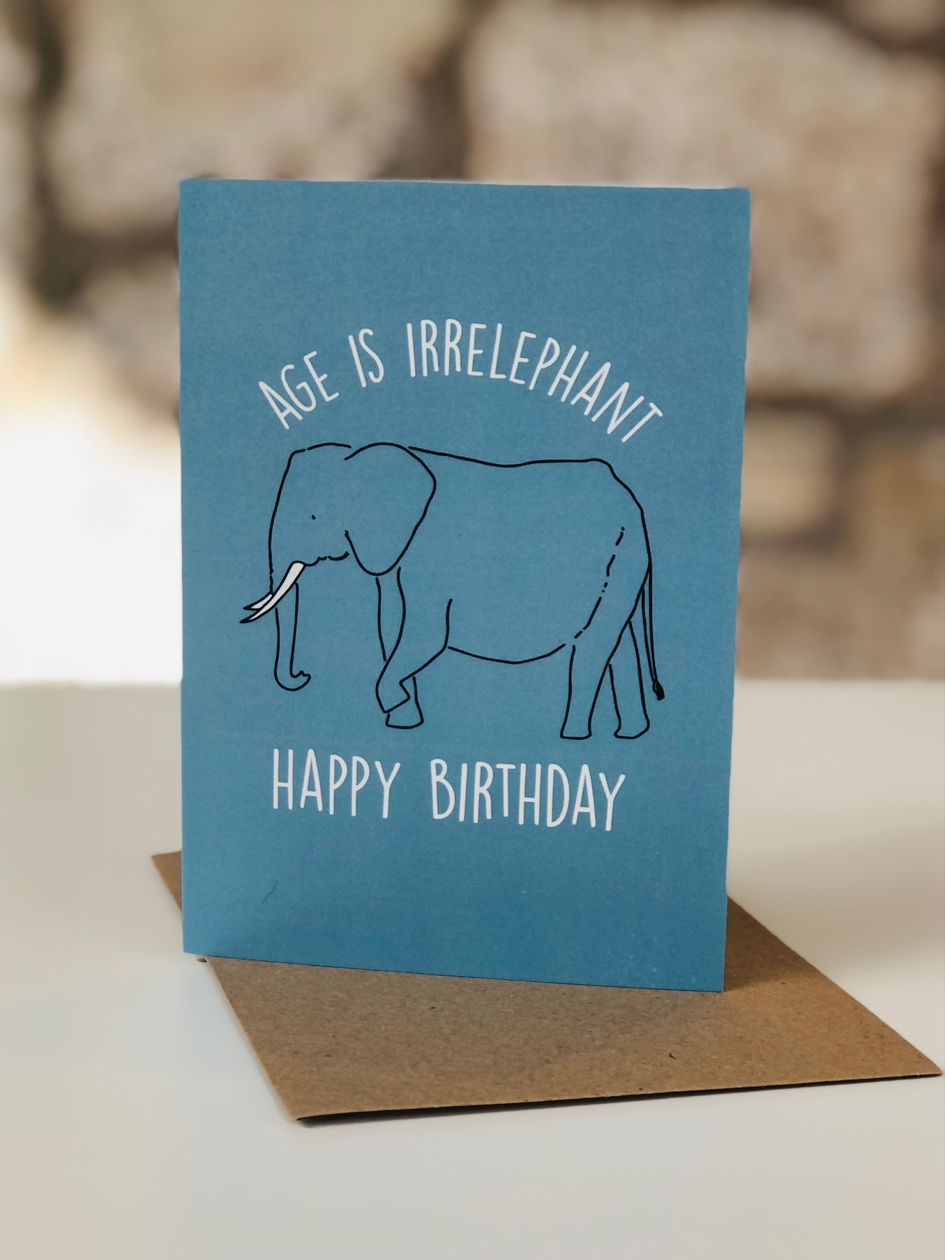 'Age is Irrelephant' Greetings Card by Emma