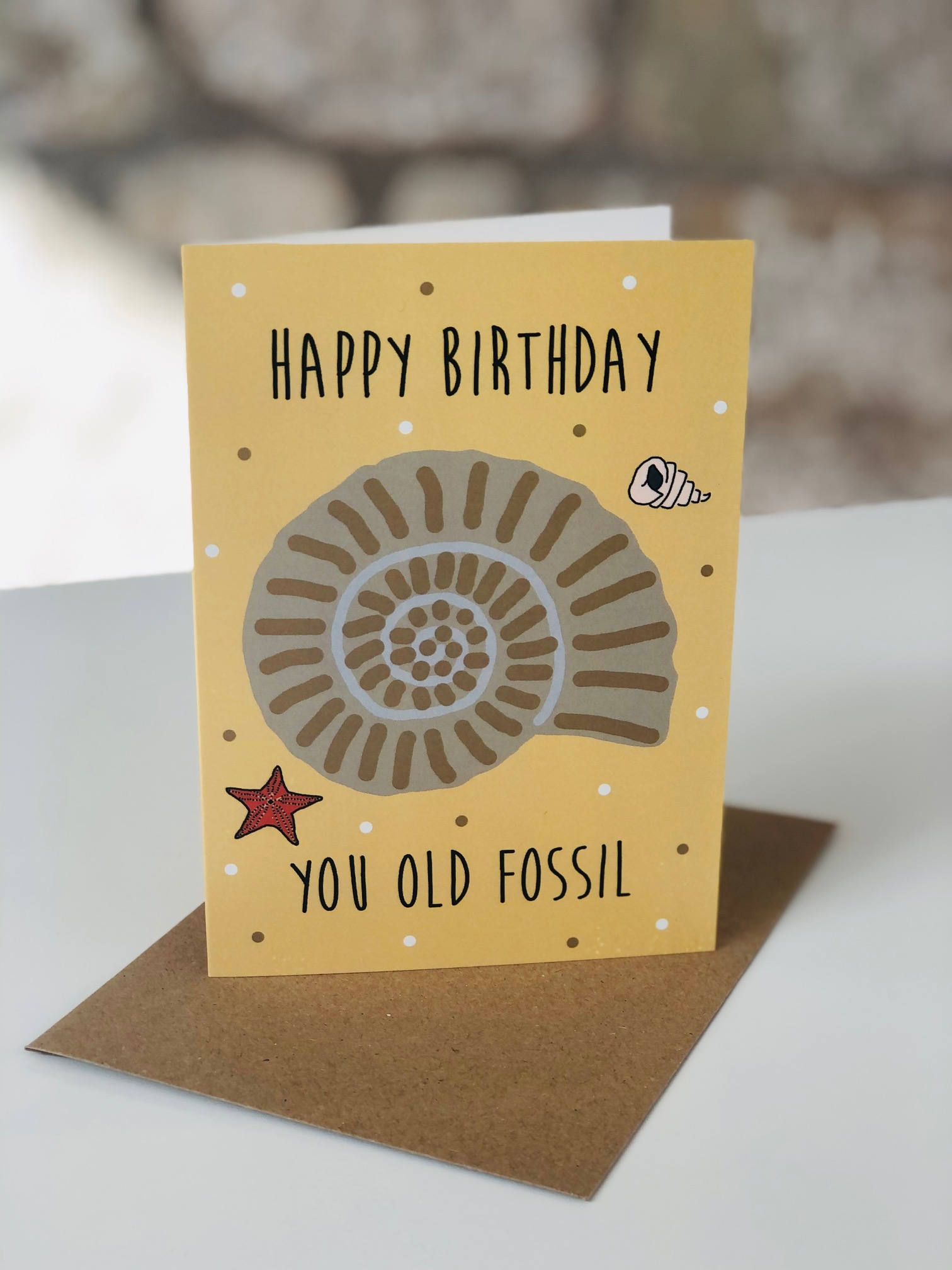 'Old Fossil' Greetings Card by Emma