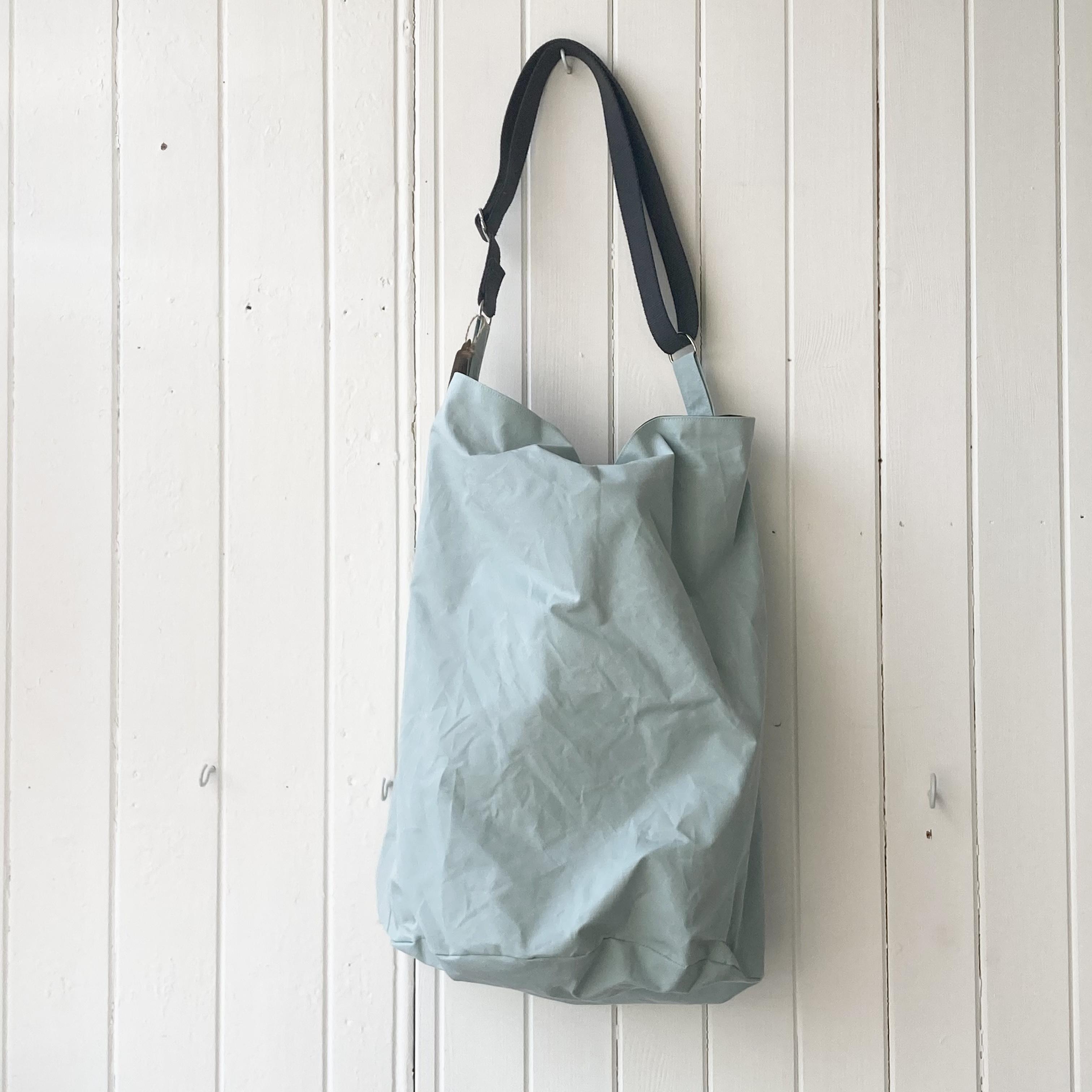 large pale blue oilskin bucket bag