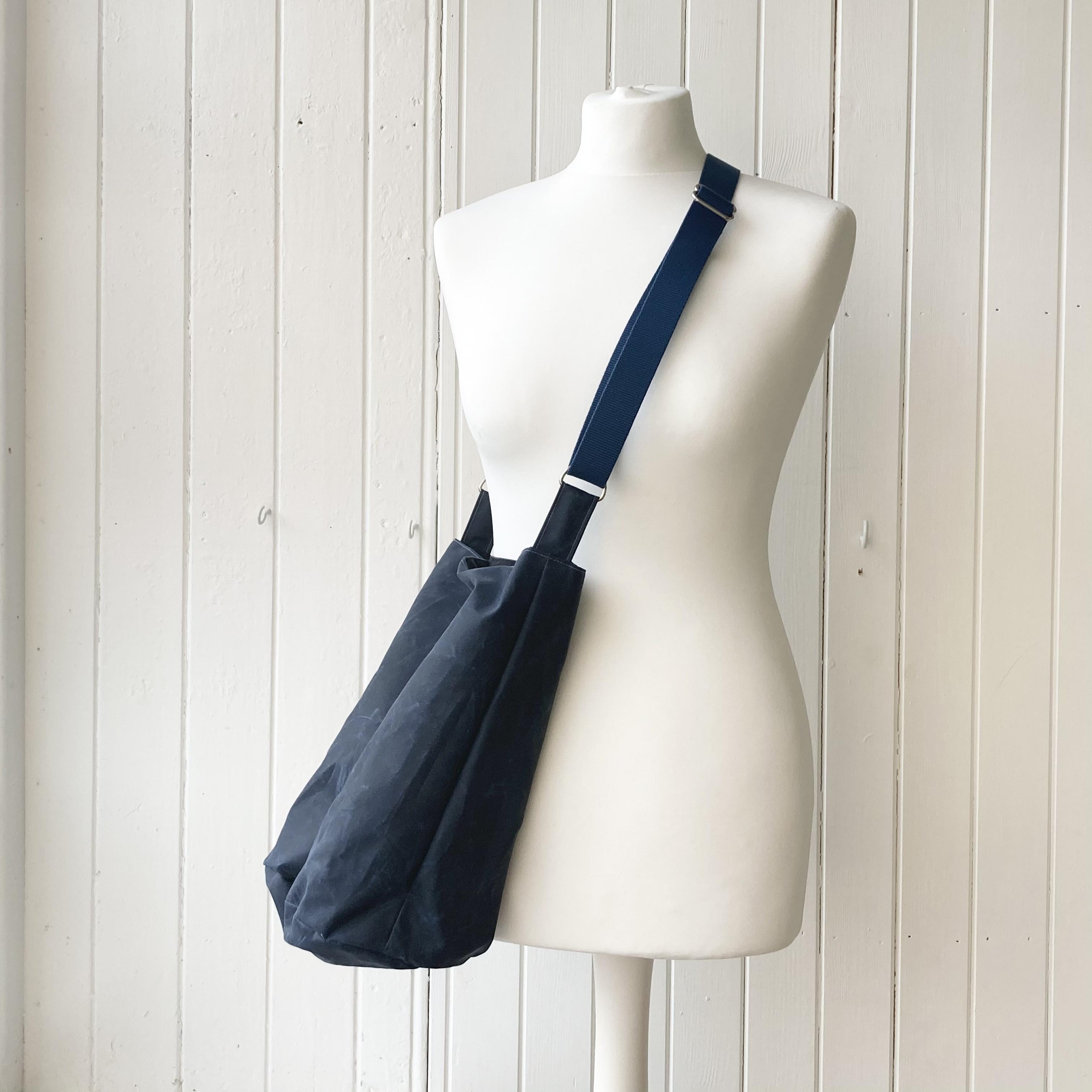 medium dark blue oilskin bucket bag