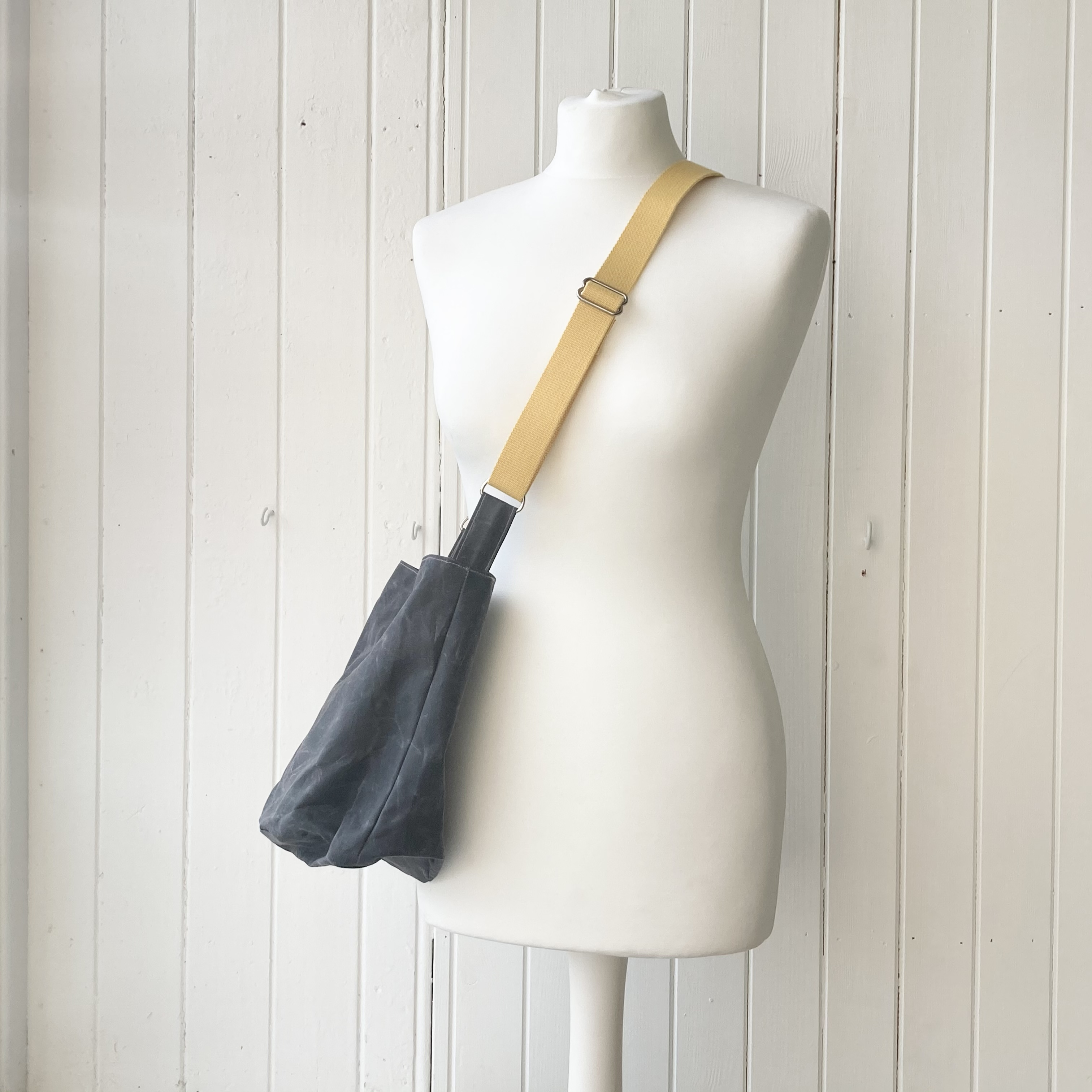 small grey and yellow oilskin bag