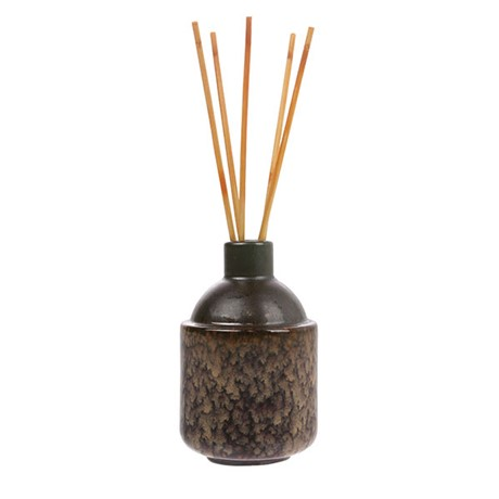 Ceramic diffuser with scented sticks