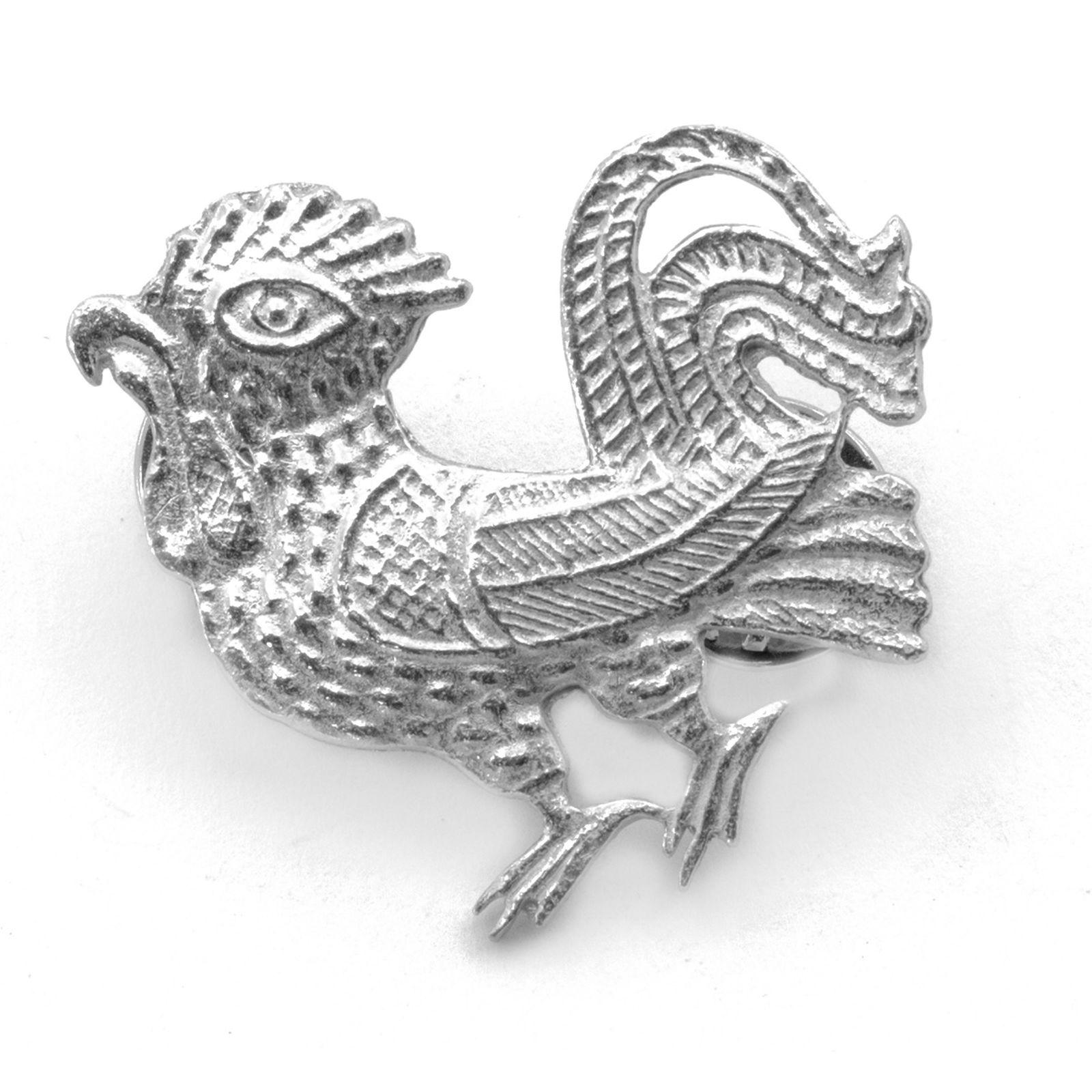Kukkopoika tinapinssi 1350-1400 luvulta tinaa