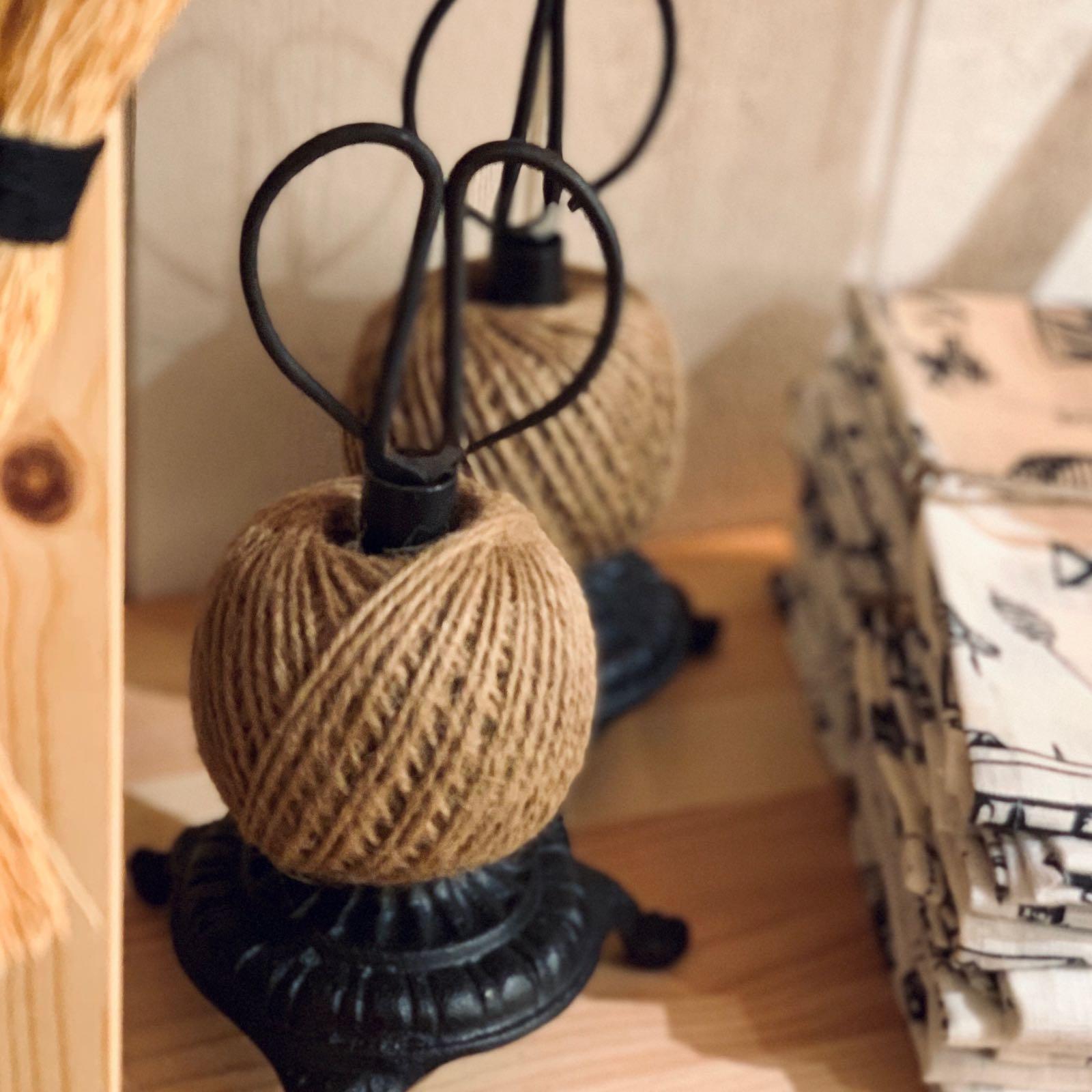 Trådhållare med sax