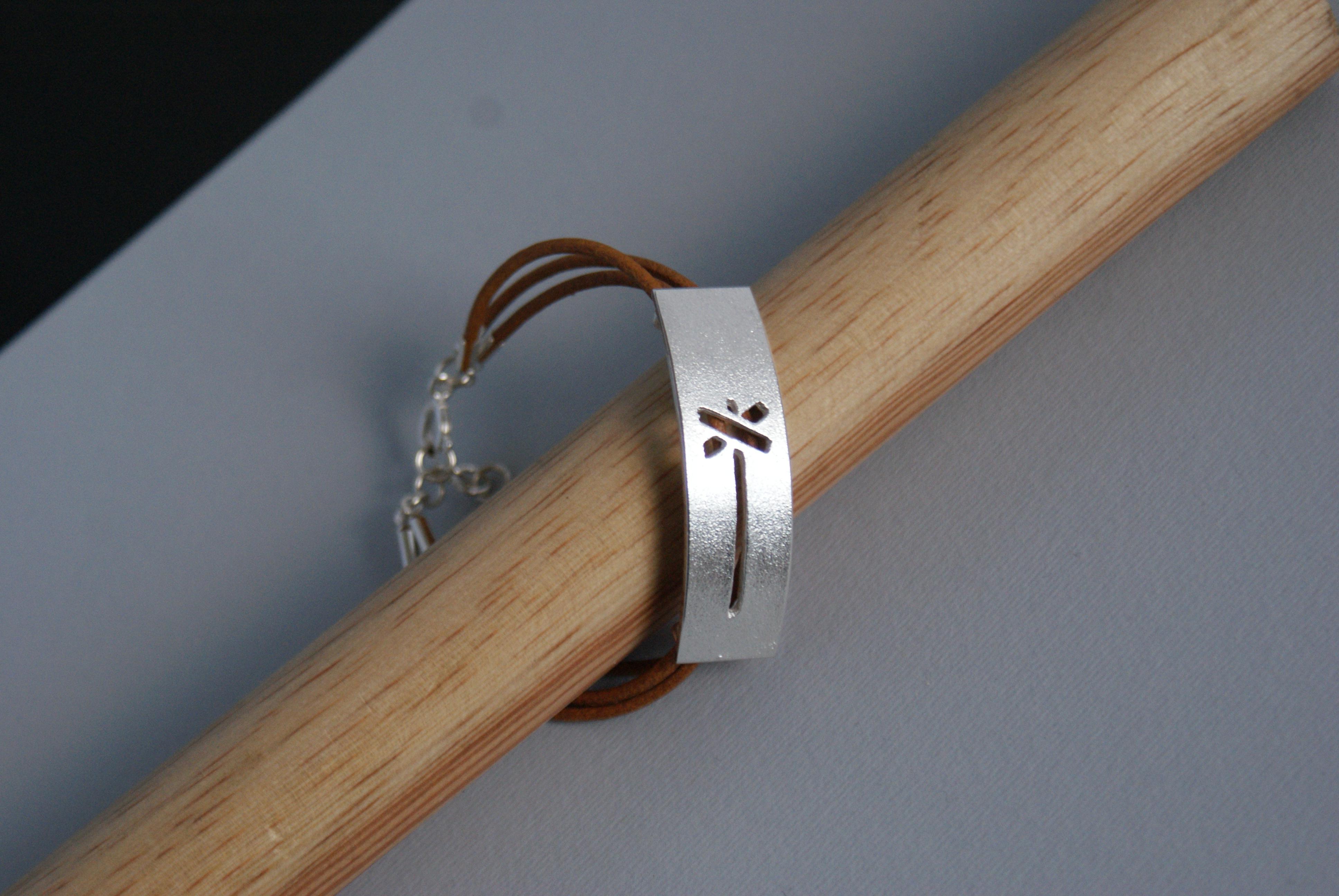 LEDKRYSS, välvt armband m läder