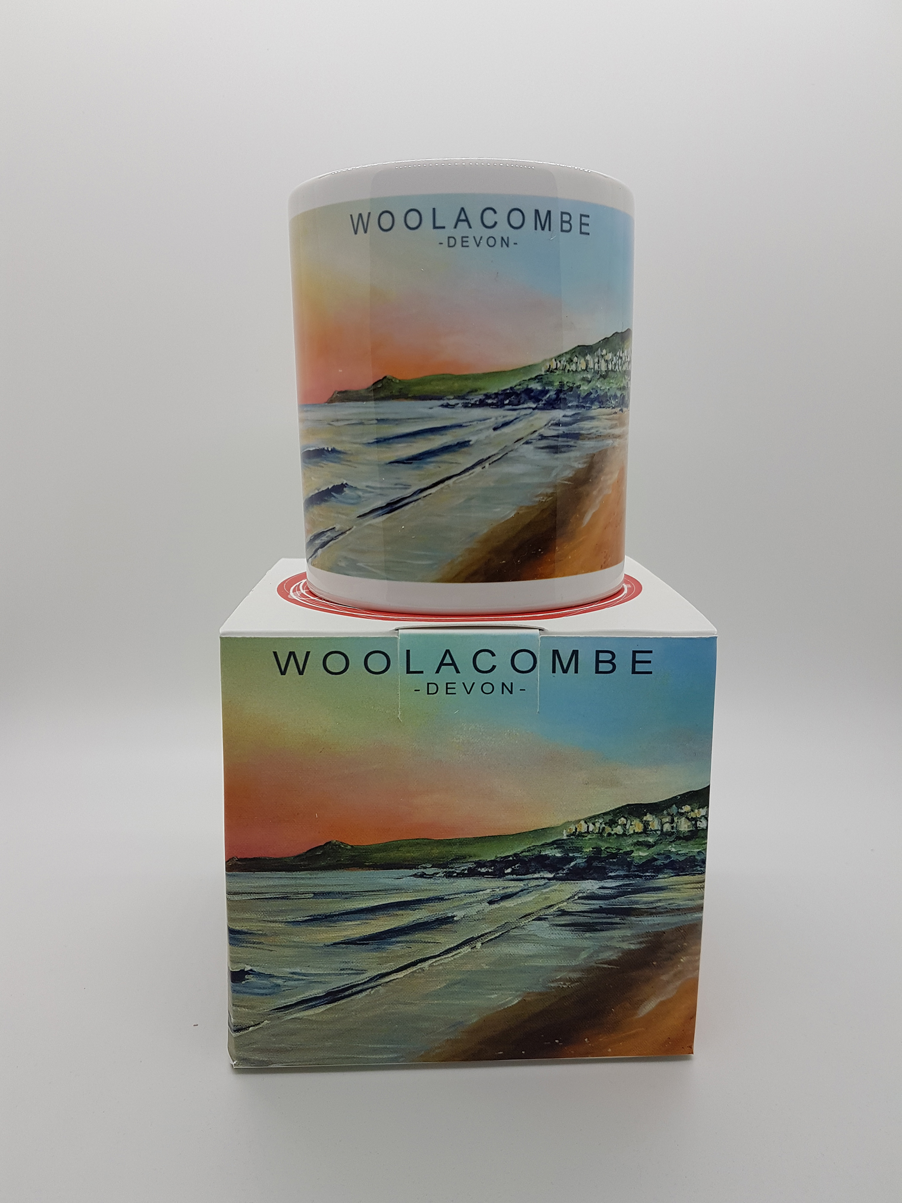 mug featuring Woolacombe beach huts at sunset