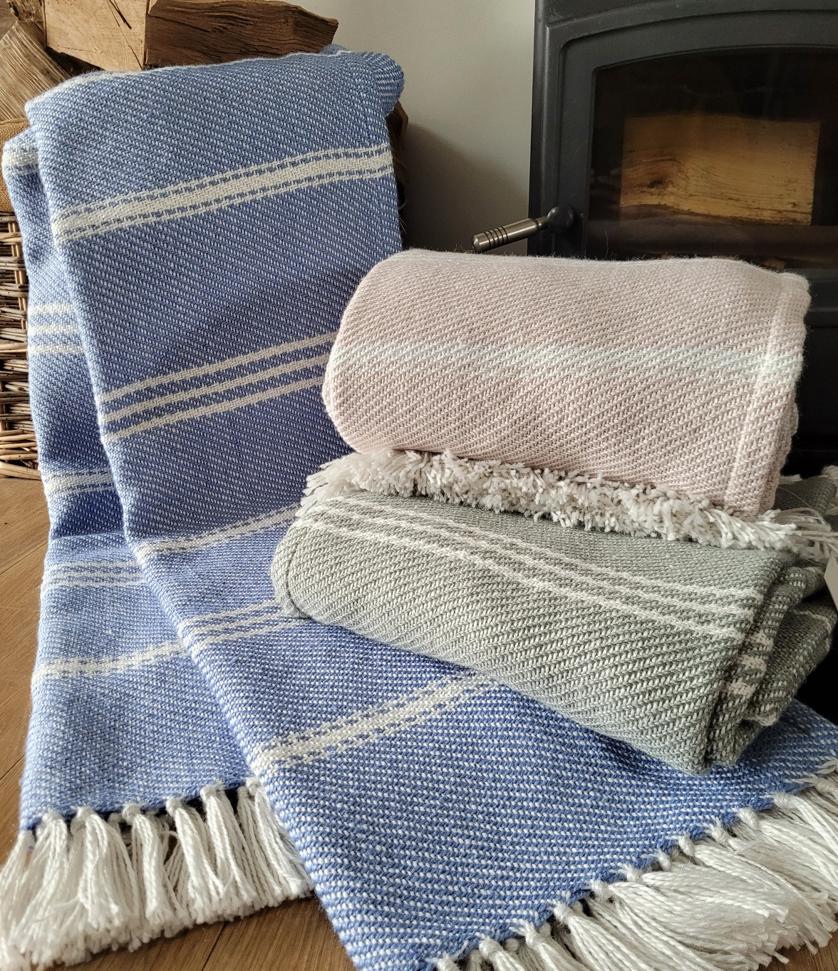 Throws. Oxford stripe. Made with 100% recycled plastic bottles