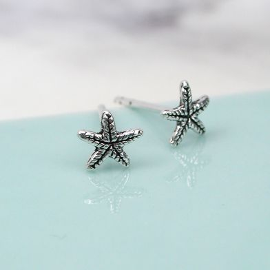 Tiny sterling silver starfish earrings