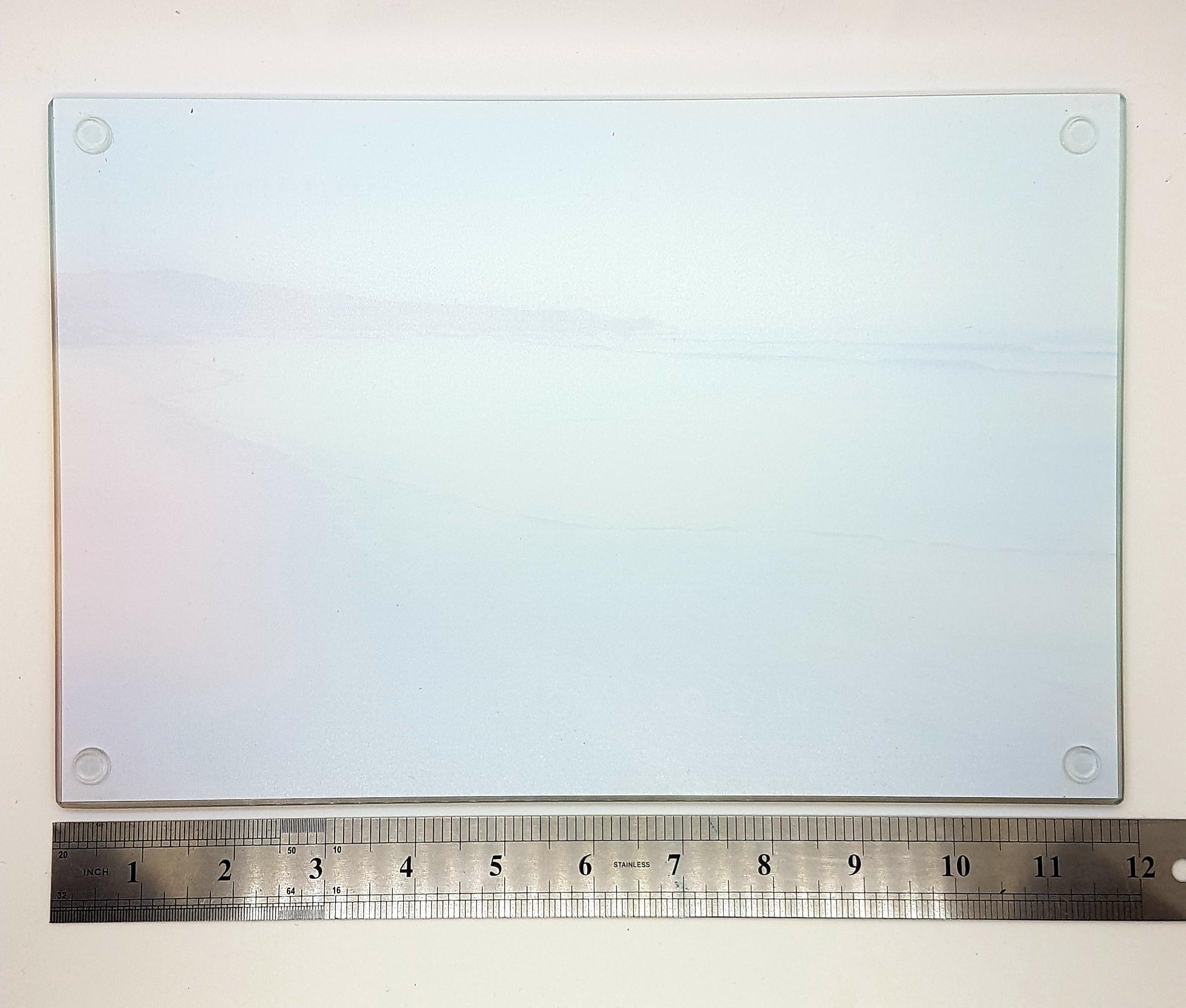 Glass worktop saver, coaster and table mat. Shoreline