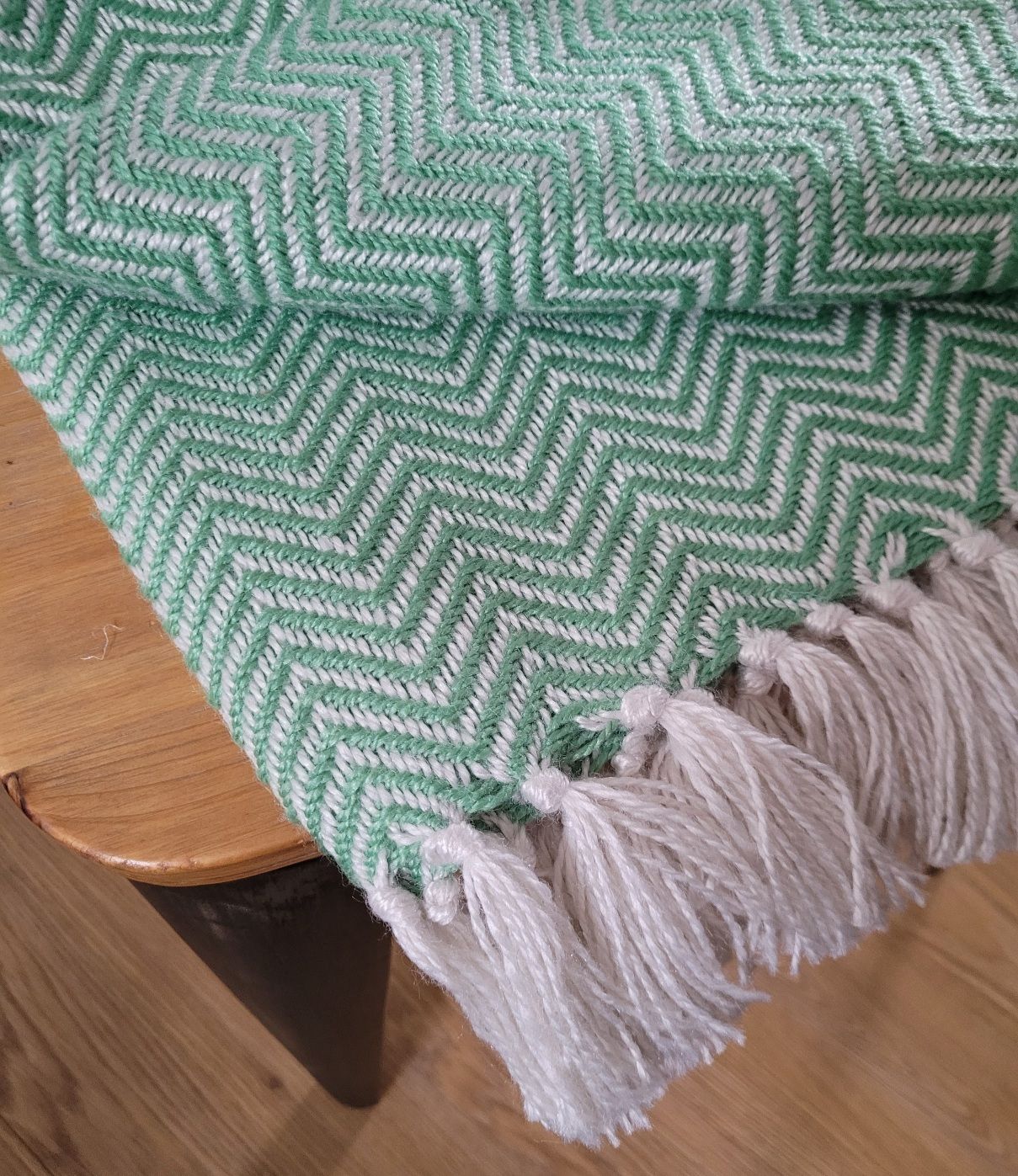 Throws. Herringbone weave. Made from 100% recycled plastic bottles.